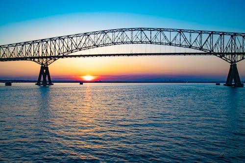 Foto stok gratis jembatan, matahari terbenam