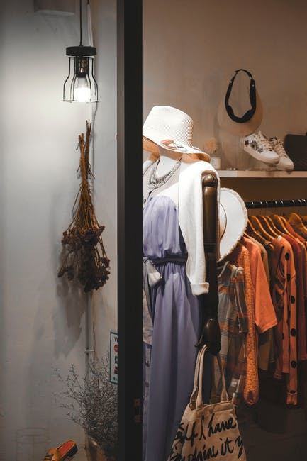 Assorted hanged clothes near white light bulb