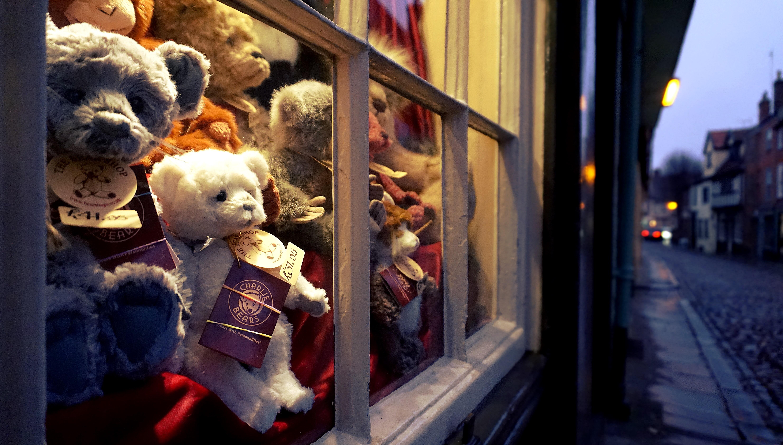 Assorted Color Bear Plush Toys Near Glass Window