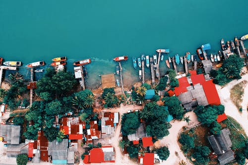 Aerial Shot of House Near Body of Water at Daytime