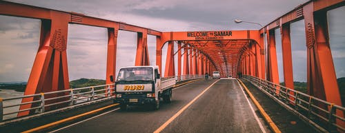 Free stock photo of bridge, dramatic sky, horizon, orange