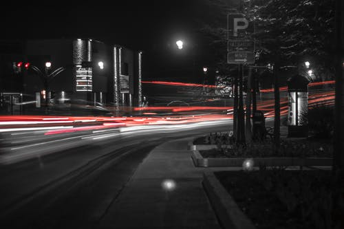 Gratis lagerfoto af aften, bevægelse, biler, billys