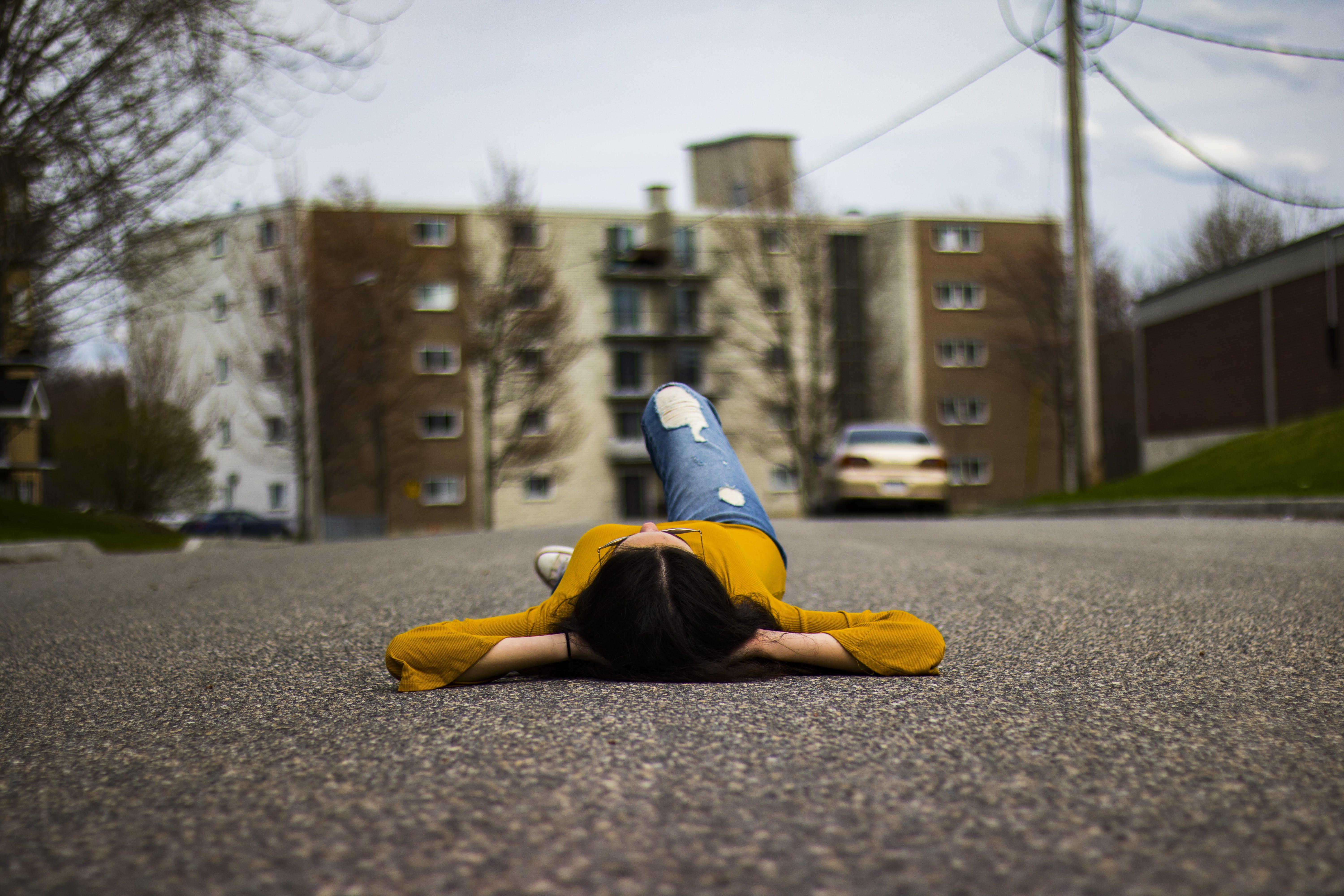 Woman Lying on the Road