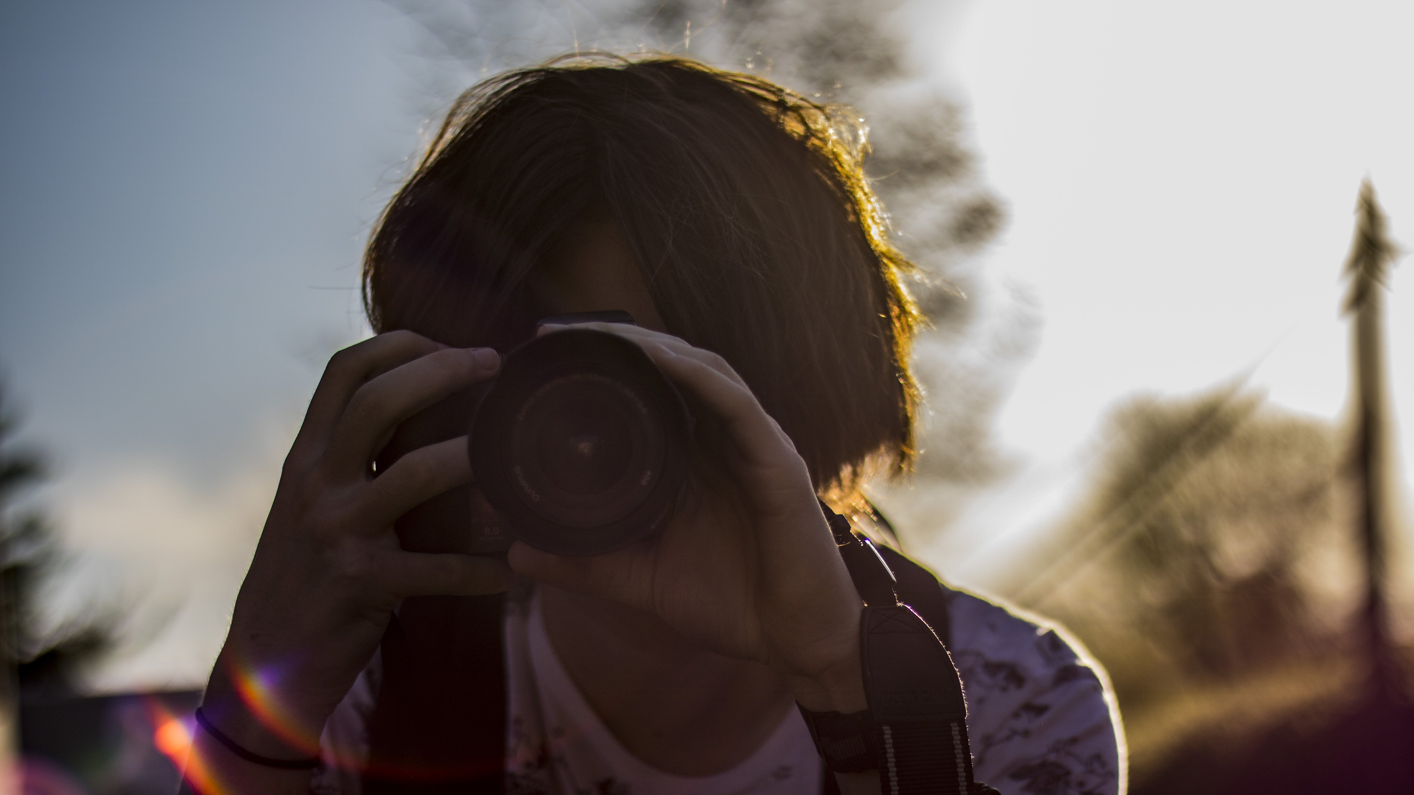 Focus Photography of Woman Using Dslr Camera