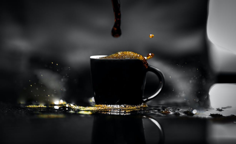 Black Ceramic Mug With Coffee
