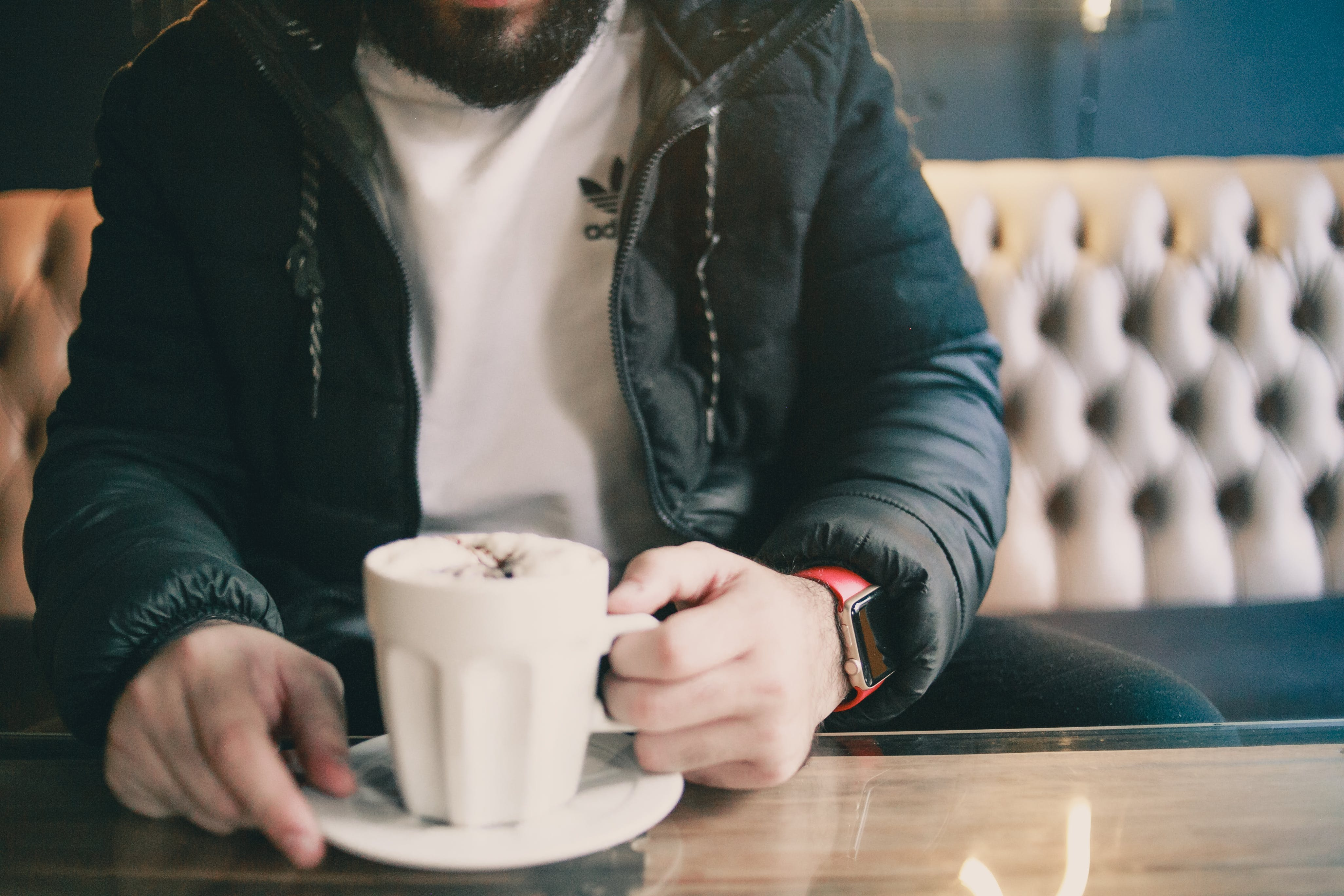 Man Holding White Ceramic Mug While Sitting on Couch