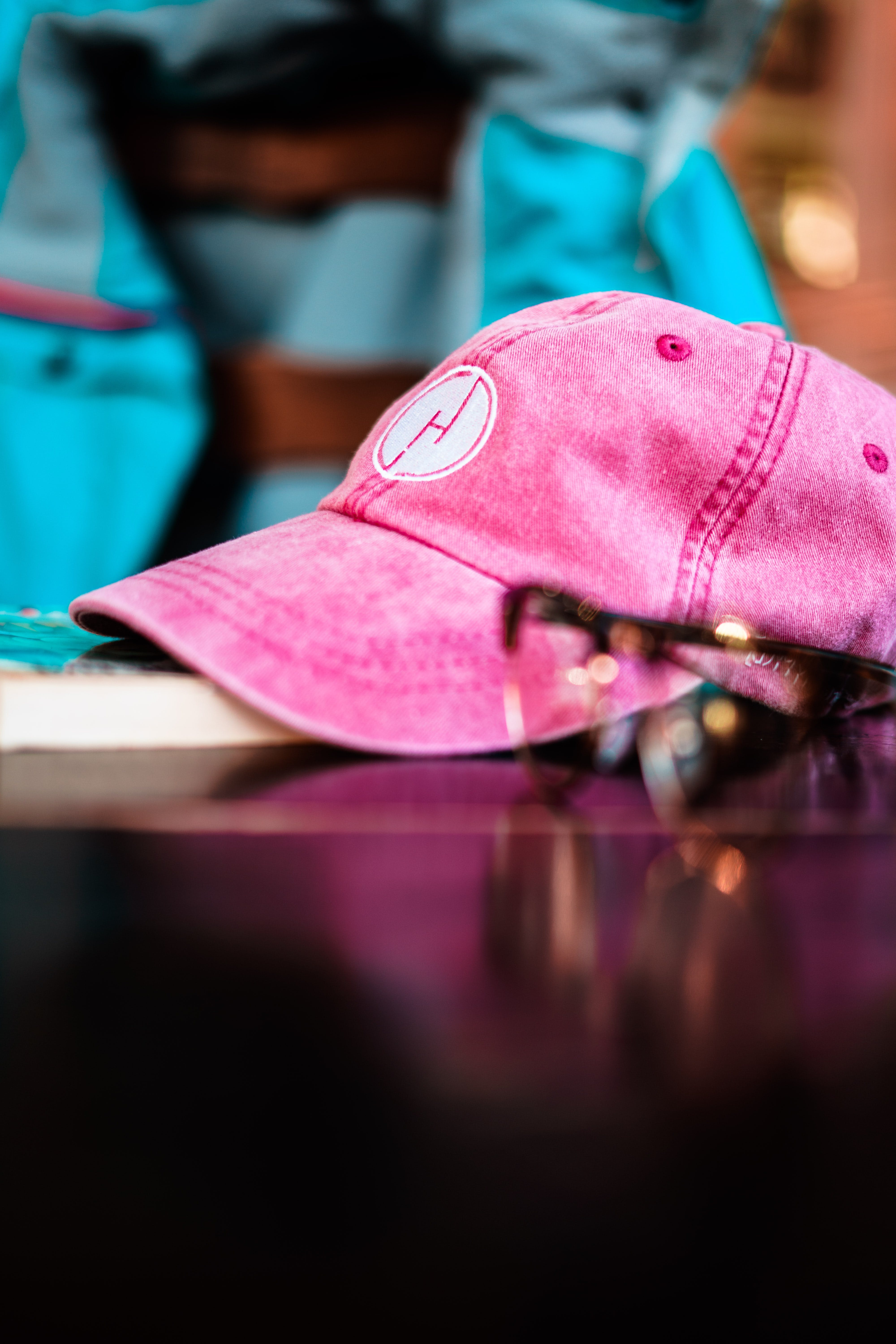 Selective Focus Photography of Pink Cap