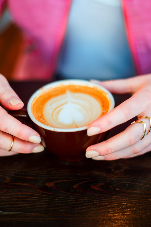 Person Hand Holding Brown Coffee Cup
