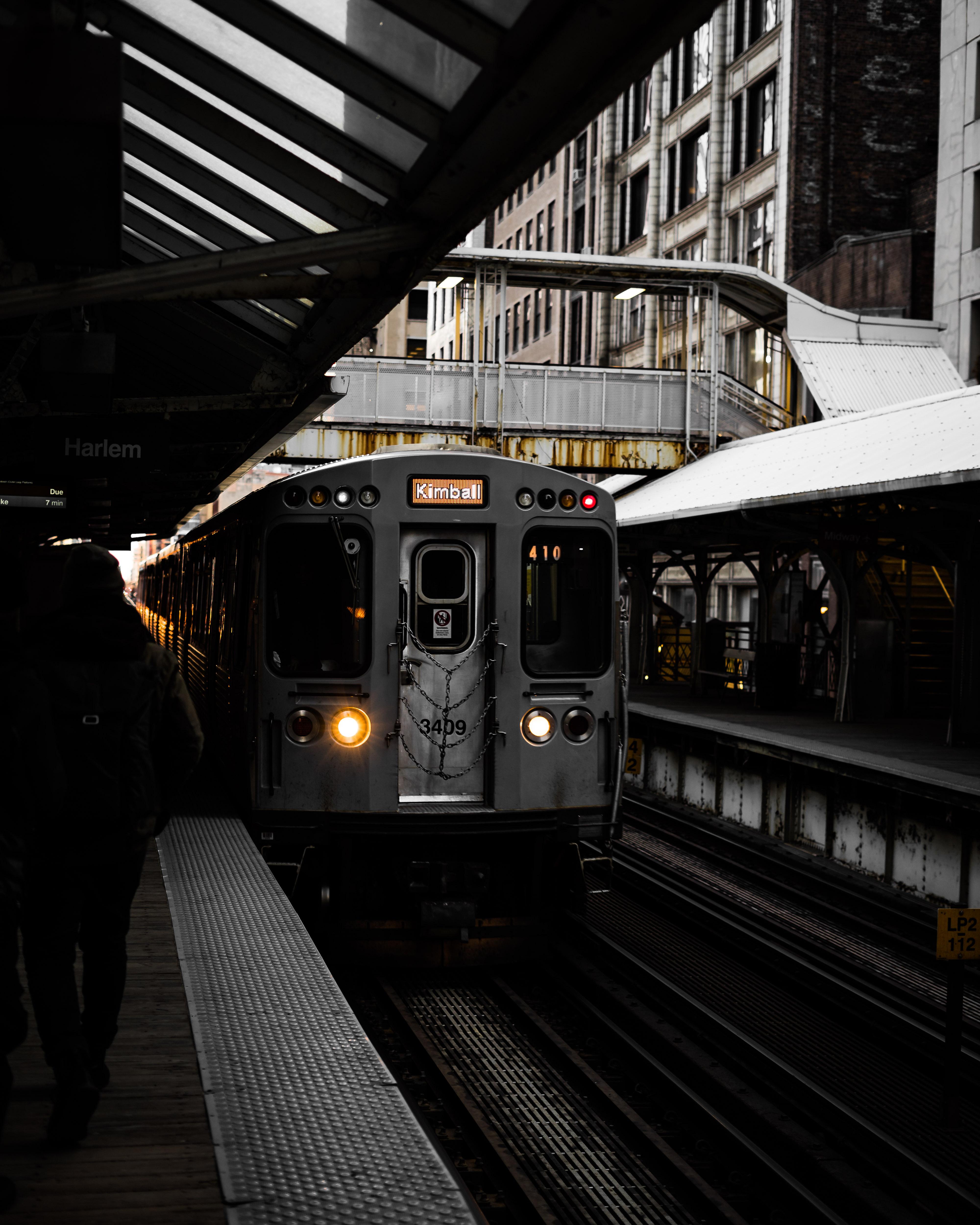 Person Standing Near Gray Train