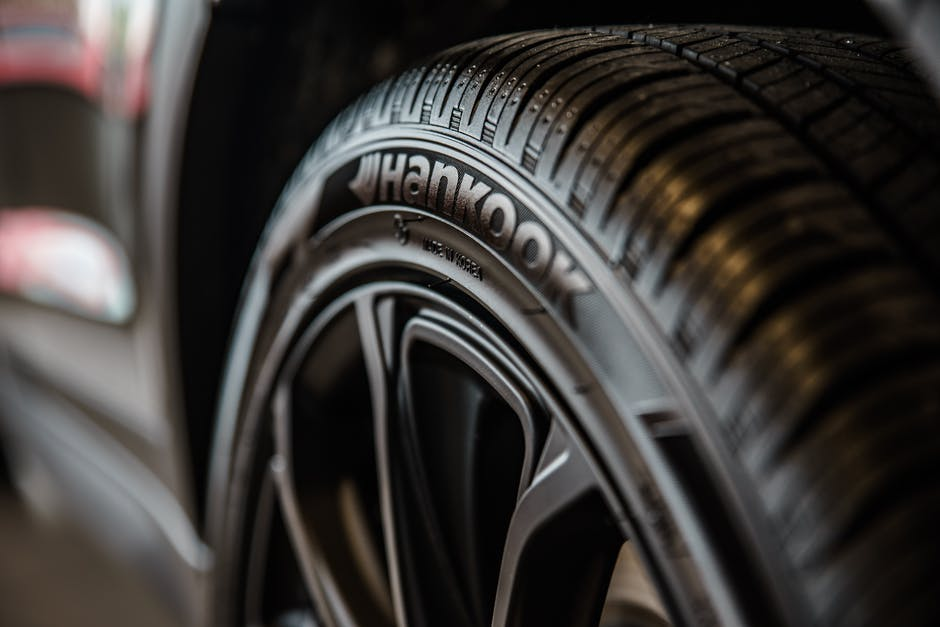 Close-up Photography of Vehicle Wheel and Hankook Tire