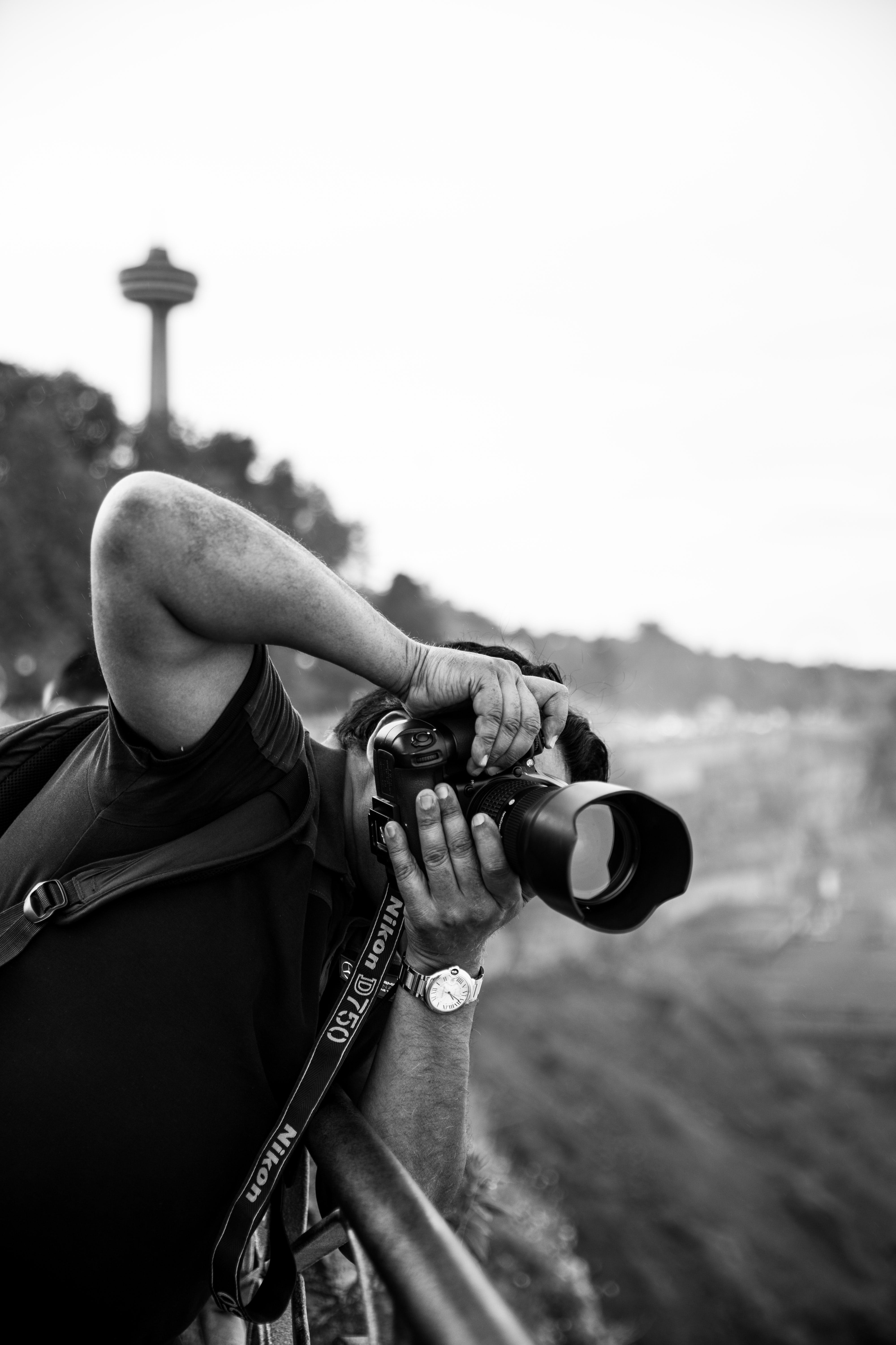 Monochrome Photography of Man Taking Picture