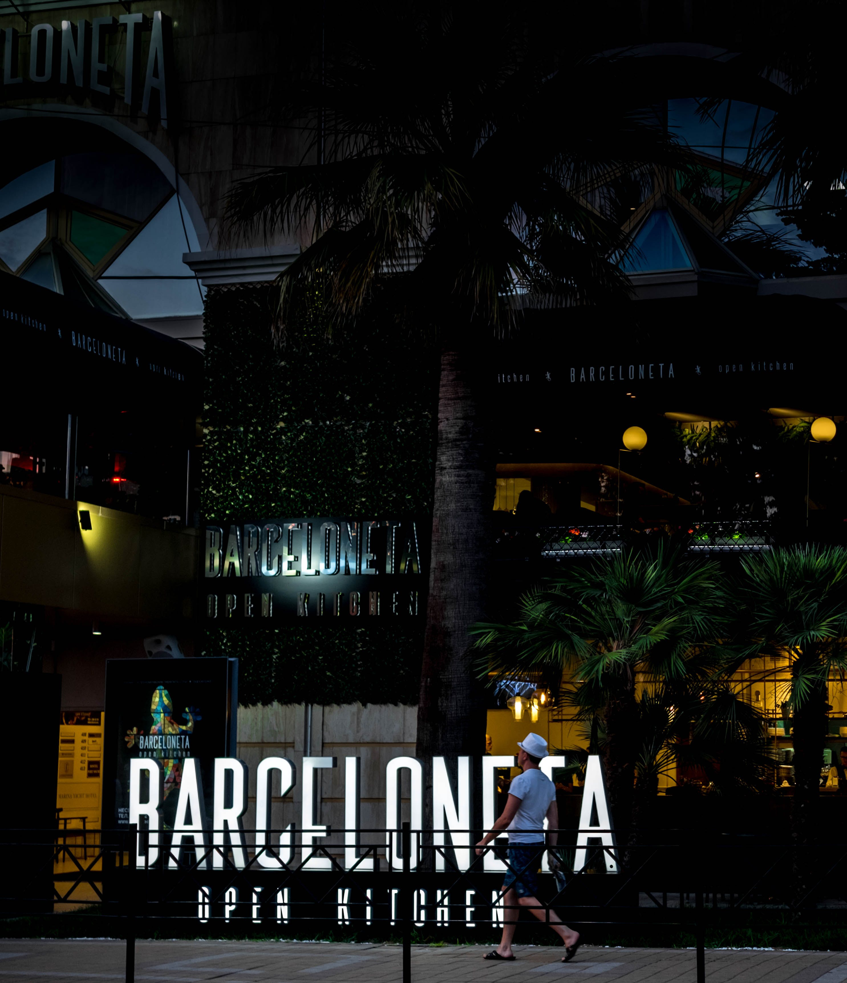 Man Walking in Front of Barceloneta Store