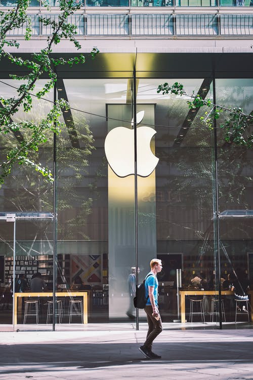 Man Passing An Apple Store