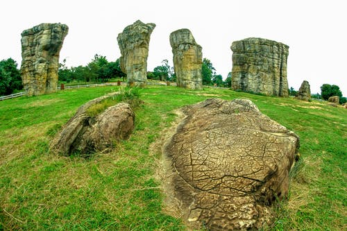 Rock Formation On Green Grass