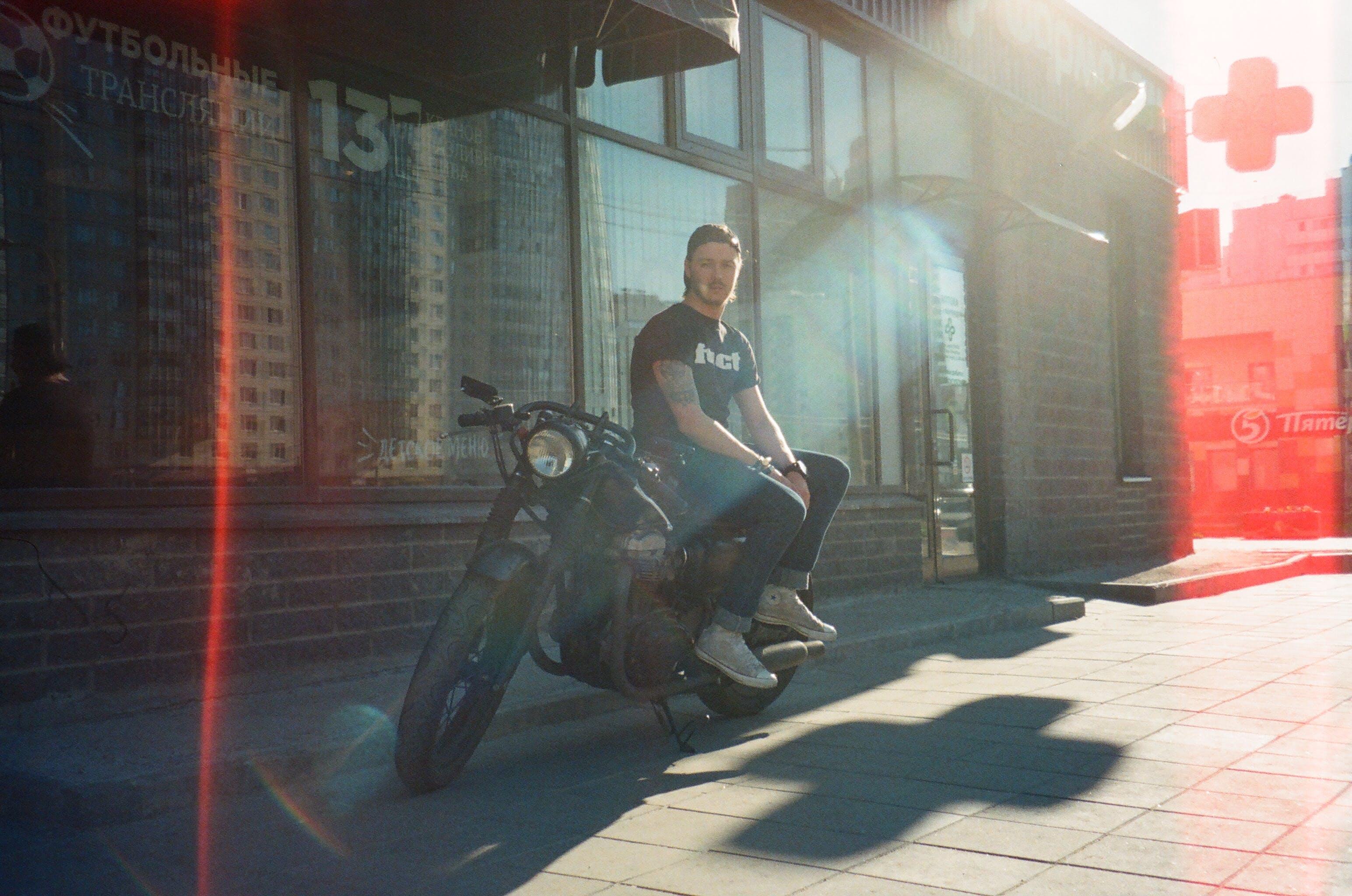 Man Sitting on Black Motorcycle