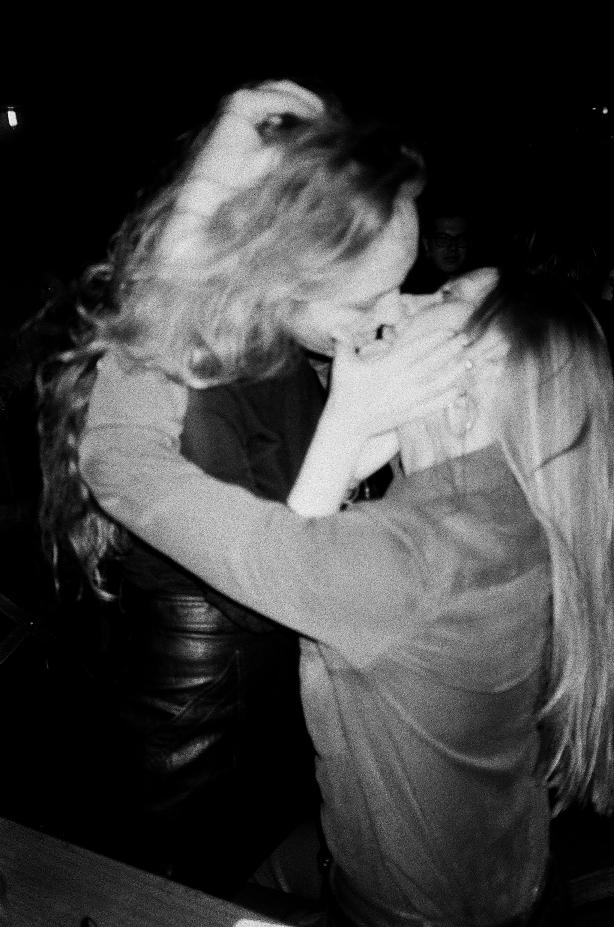 Grayscale Photo of Woman and Woman Kissing