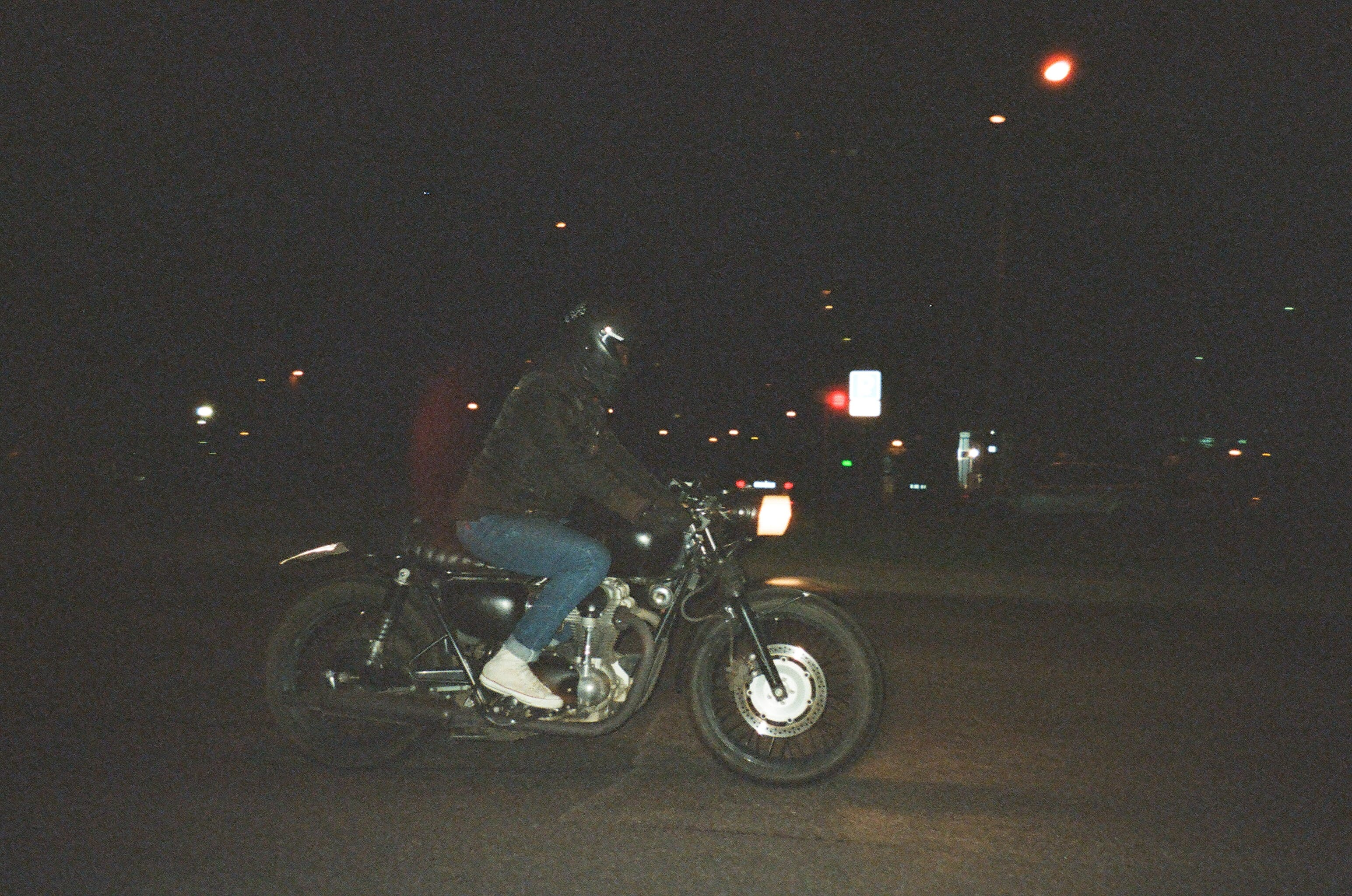 Person Riding on Motorcycle on Road during Nighttime