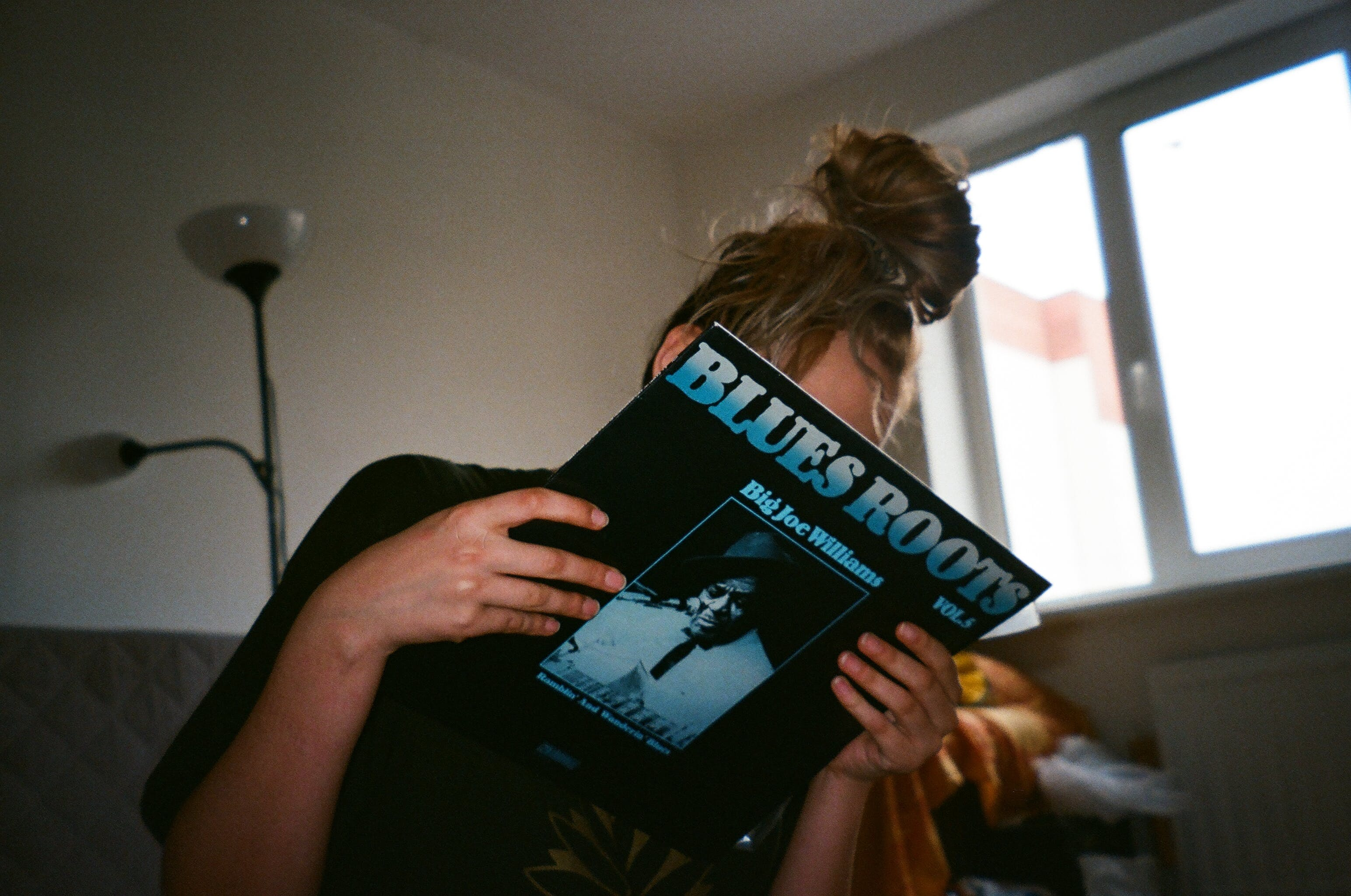 Person Holding Blues Roots Record Sleeve