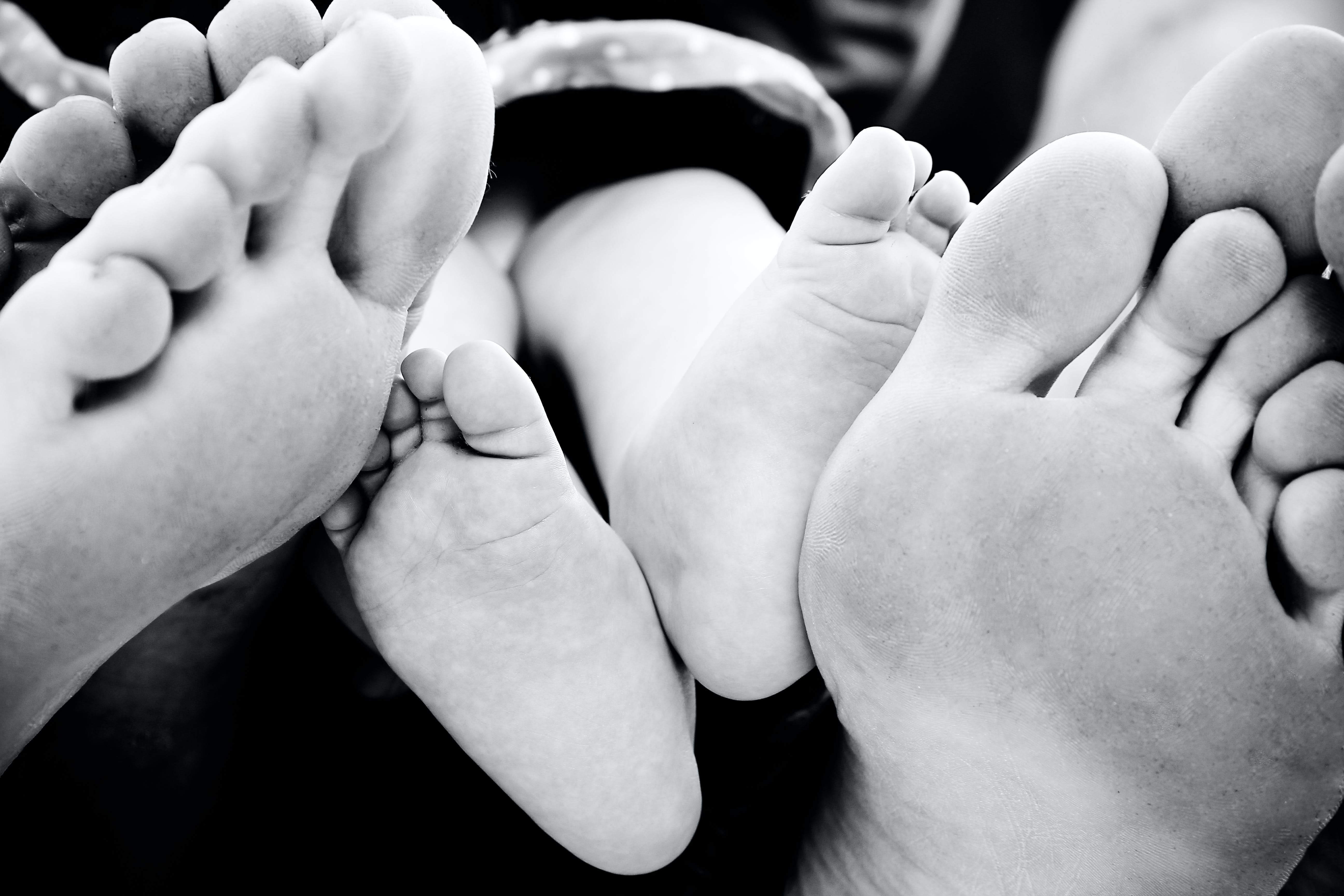 baby feet, black and white, family