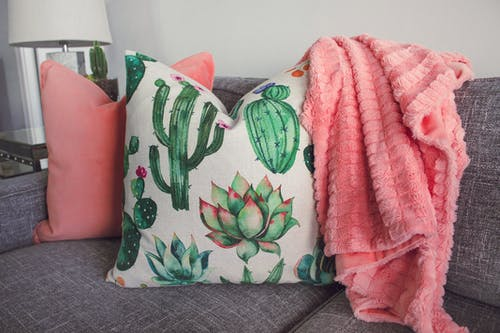 White Cactus-printed Throw Pillow on Gray Couch