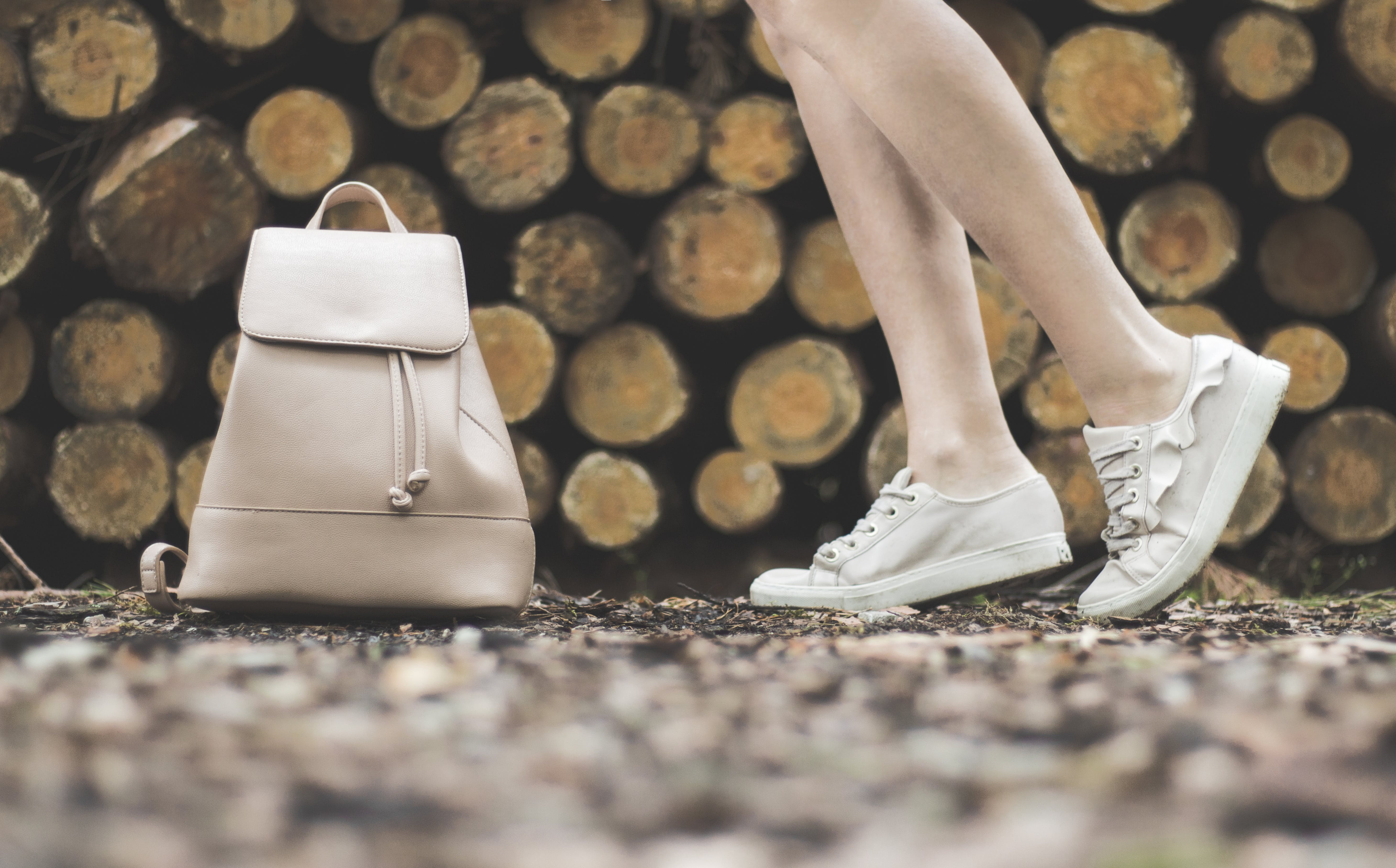 Woman Standing Near White Leather Backpack