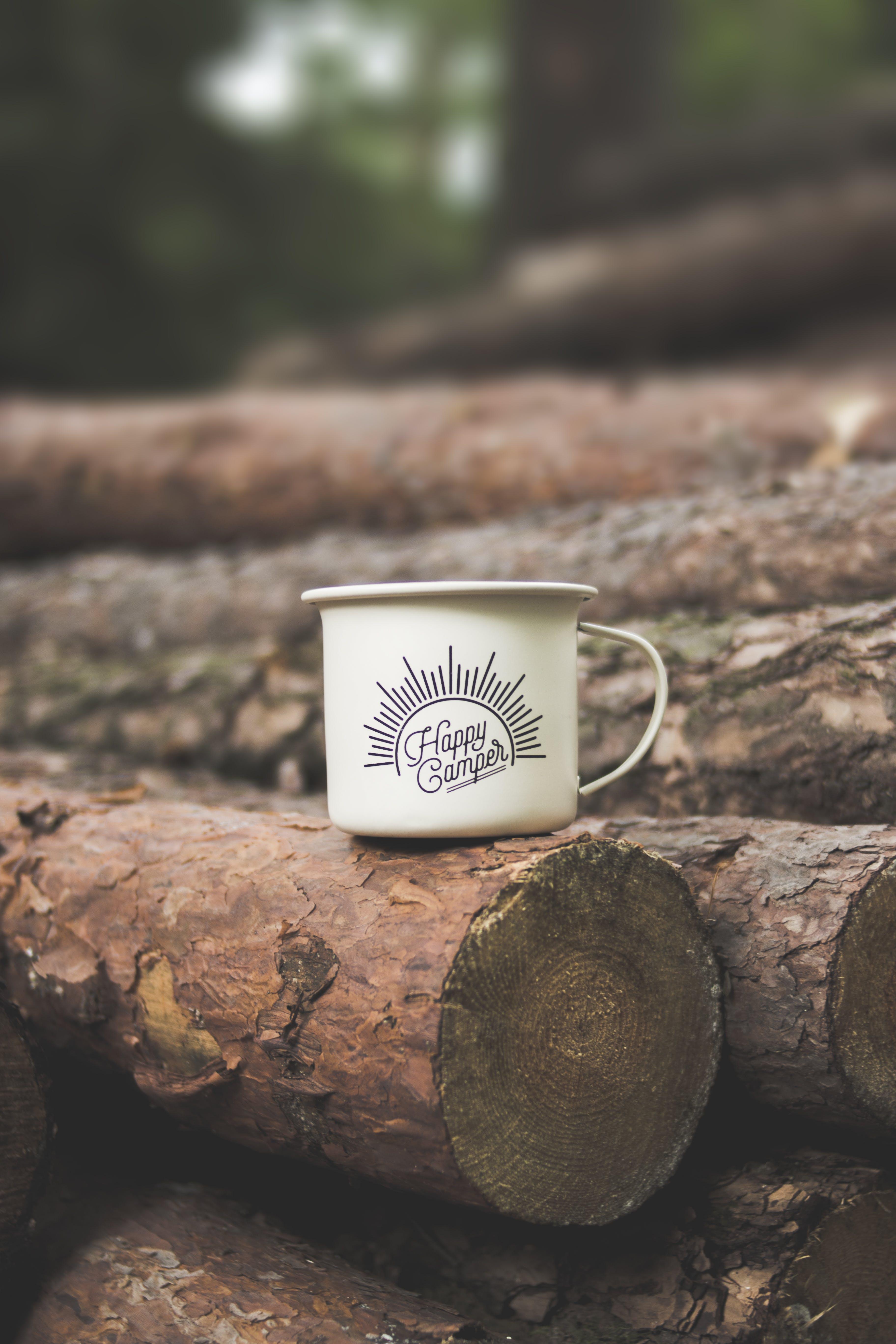White Happy Camper-printed Cup on Brown Wooden Log