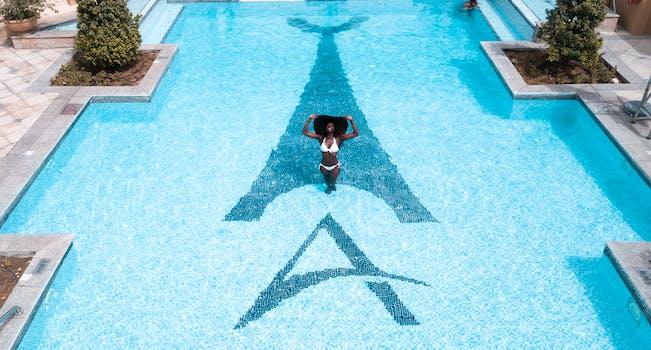 Woman in White Bikini Standing on Swimming Pool