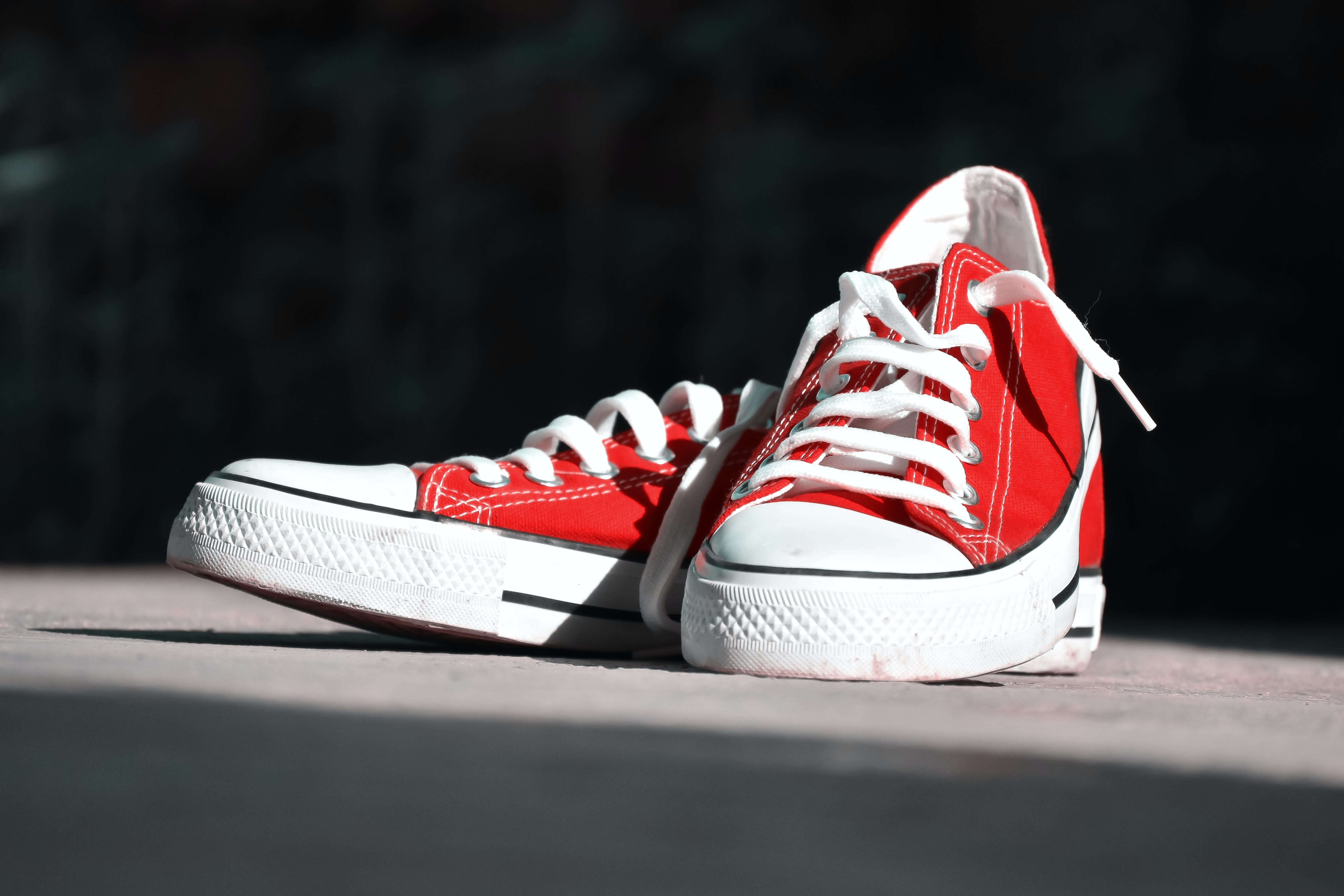 Shallow Focus Photography of Pair of Red Low-top Sneakers