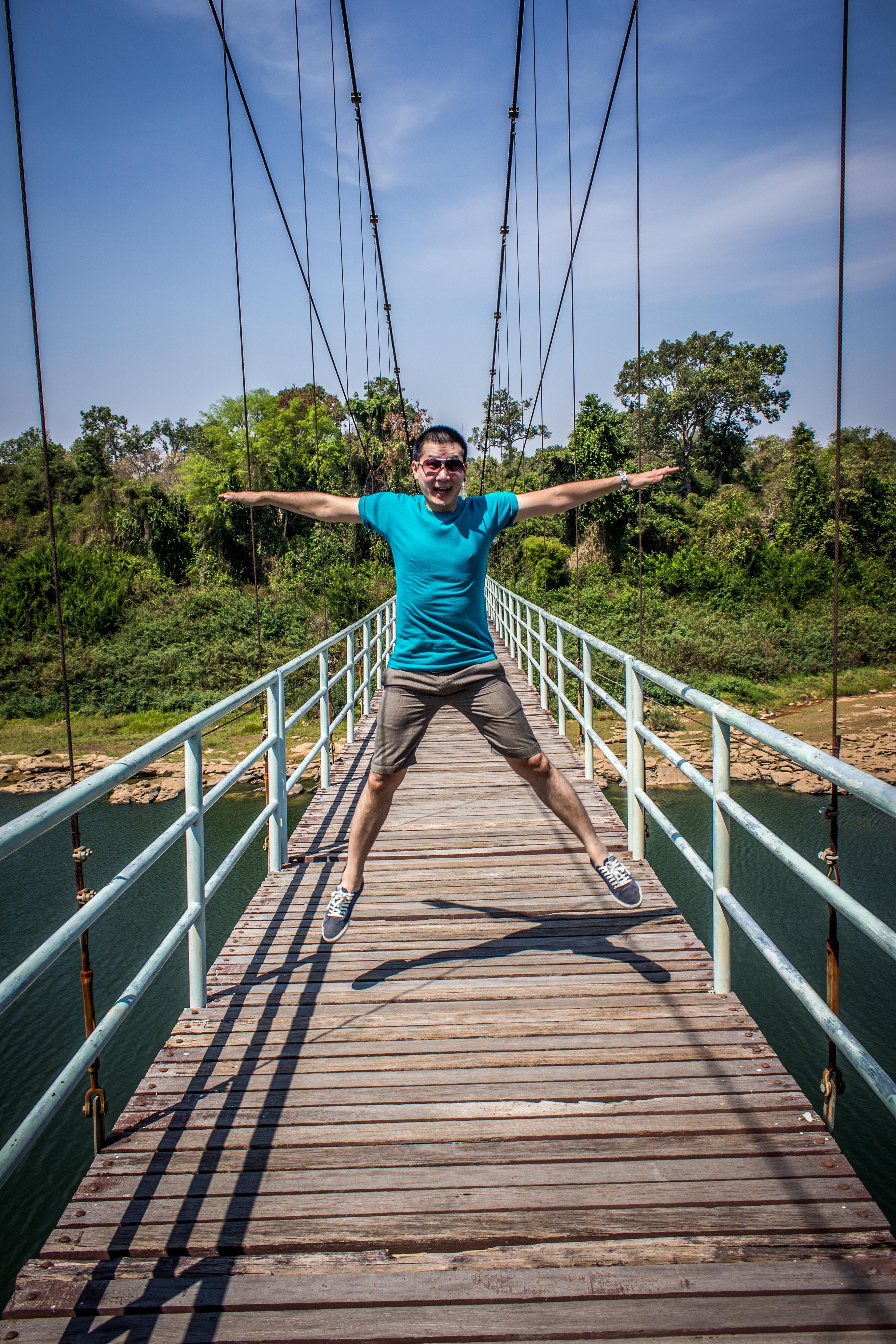 Man Jumping On Bridge