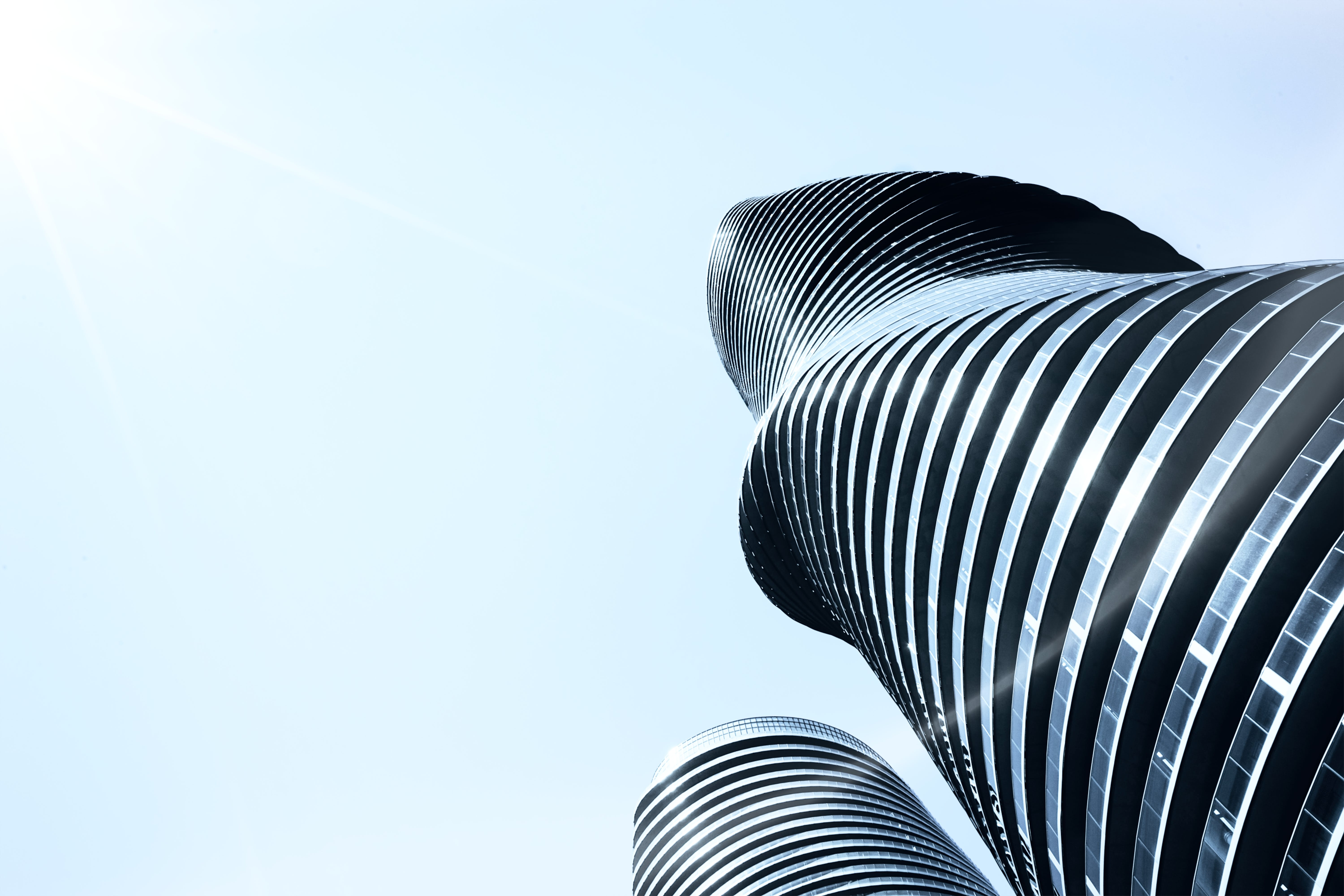 Low-angle Photography of Spiraling High-rise Building