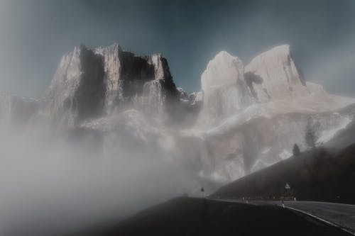 Gray Rock Formation Mountain Covered With Fog