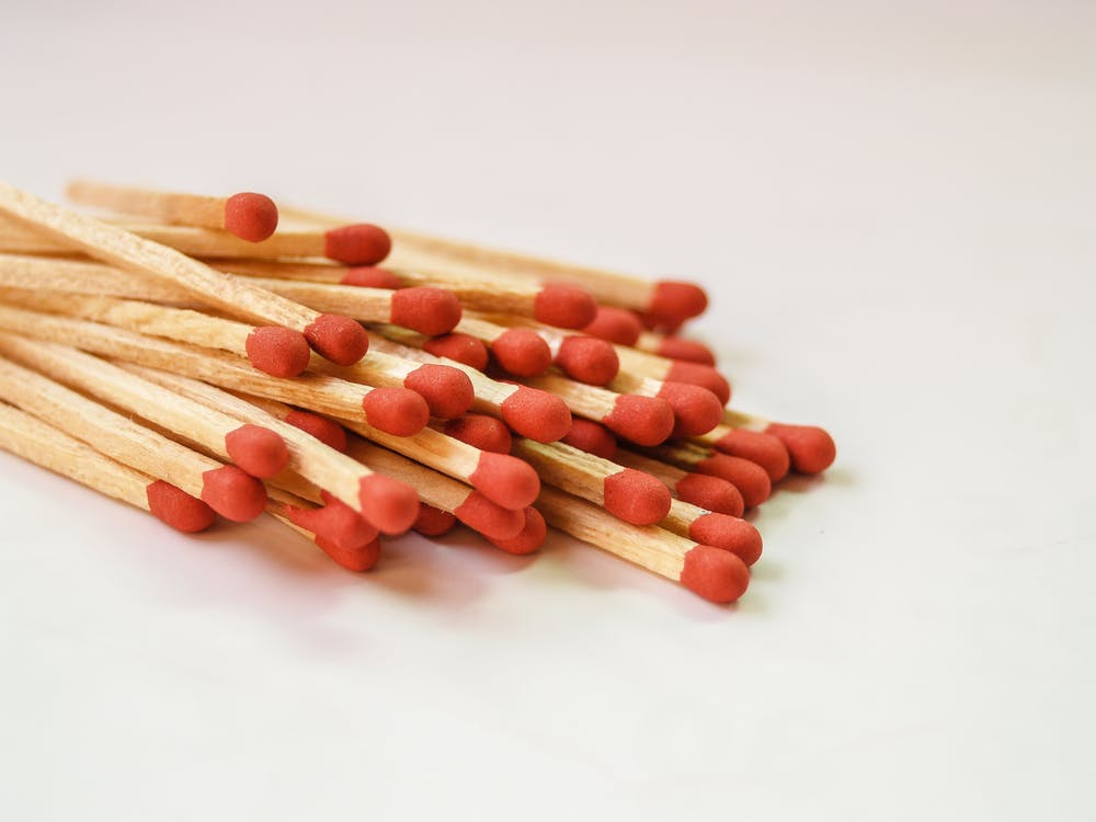Photography of Piled Red Matchsticks