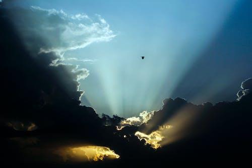 Gratis arkivbilde med gyllen sol, skyer