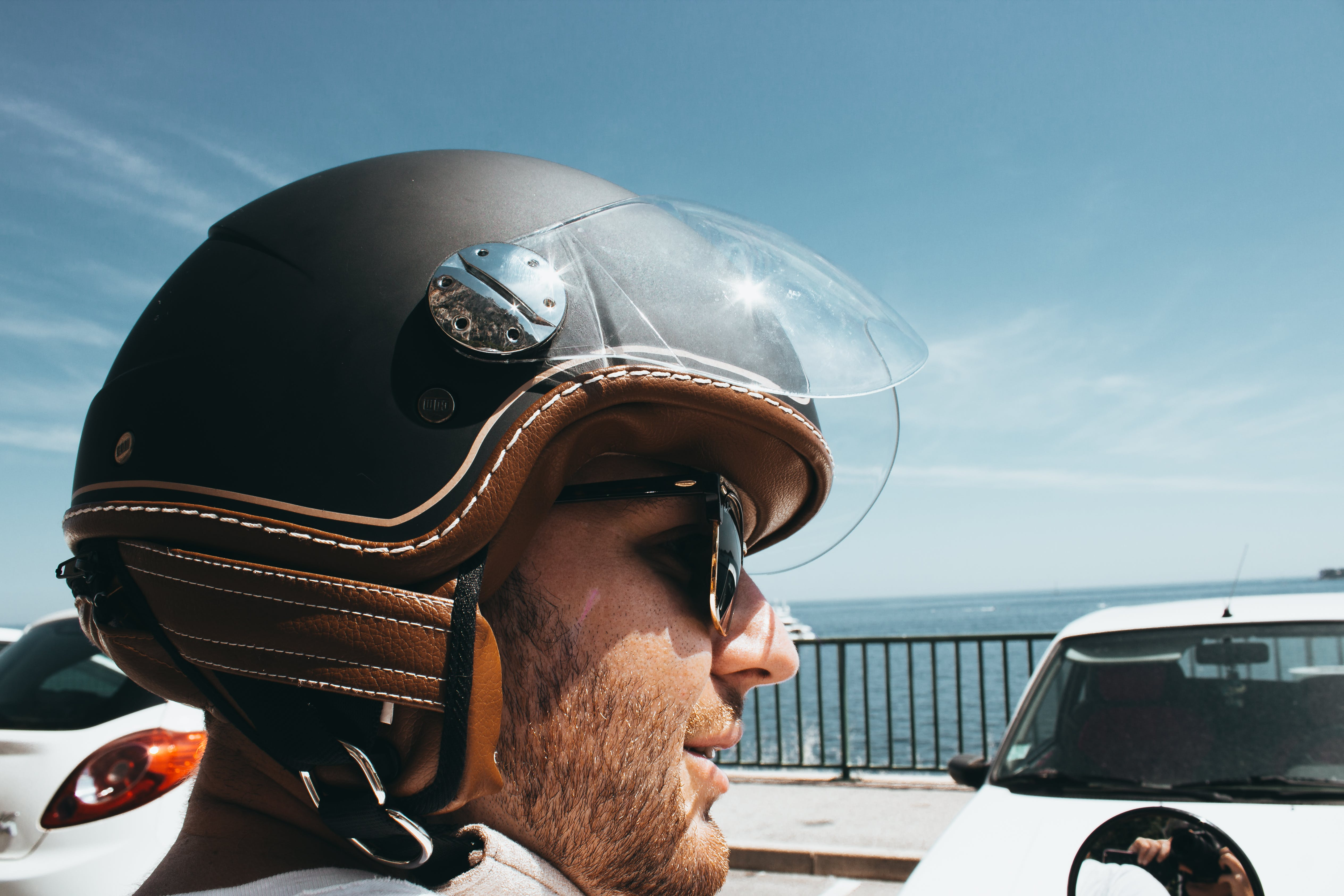 Man Wearing Black-and-brown Half-face Helmet and Black Sunglasses