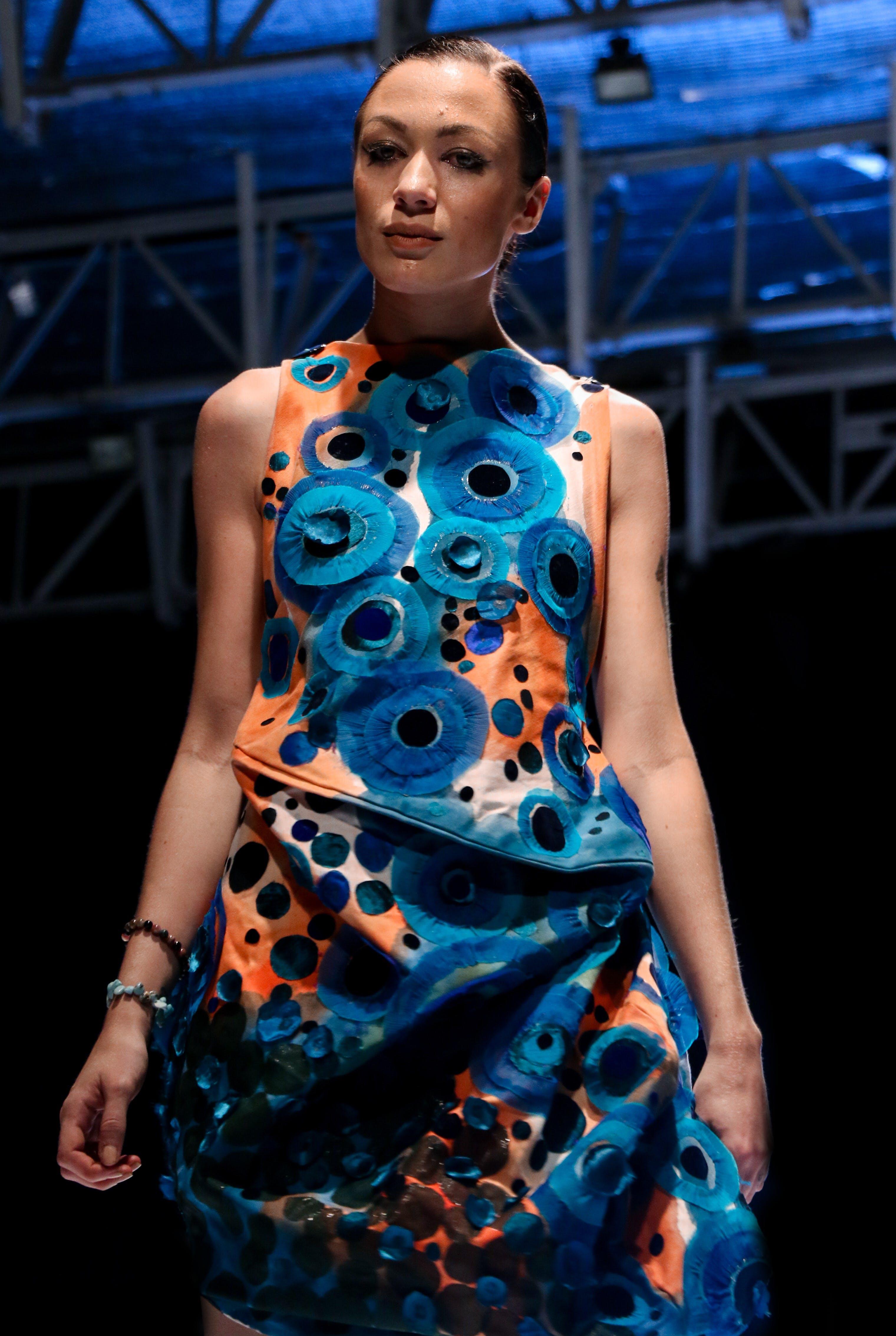 Woman Wearing a Multicolored Sleeveless Dress