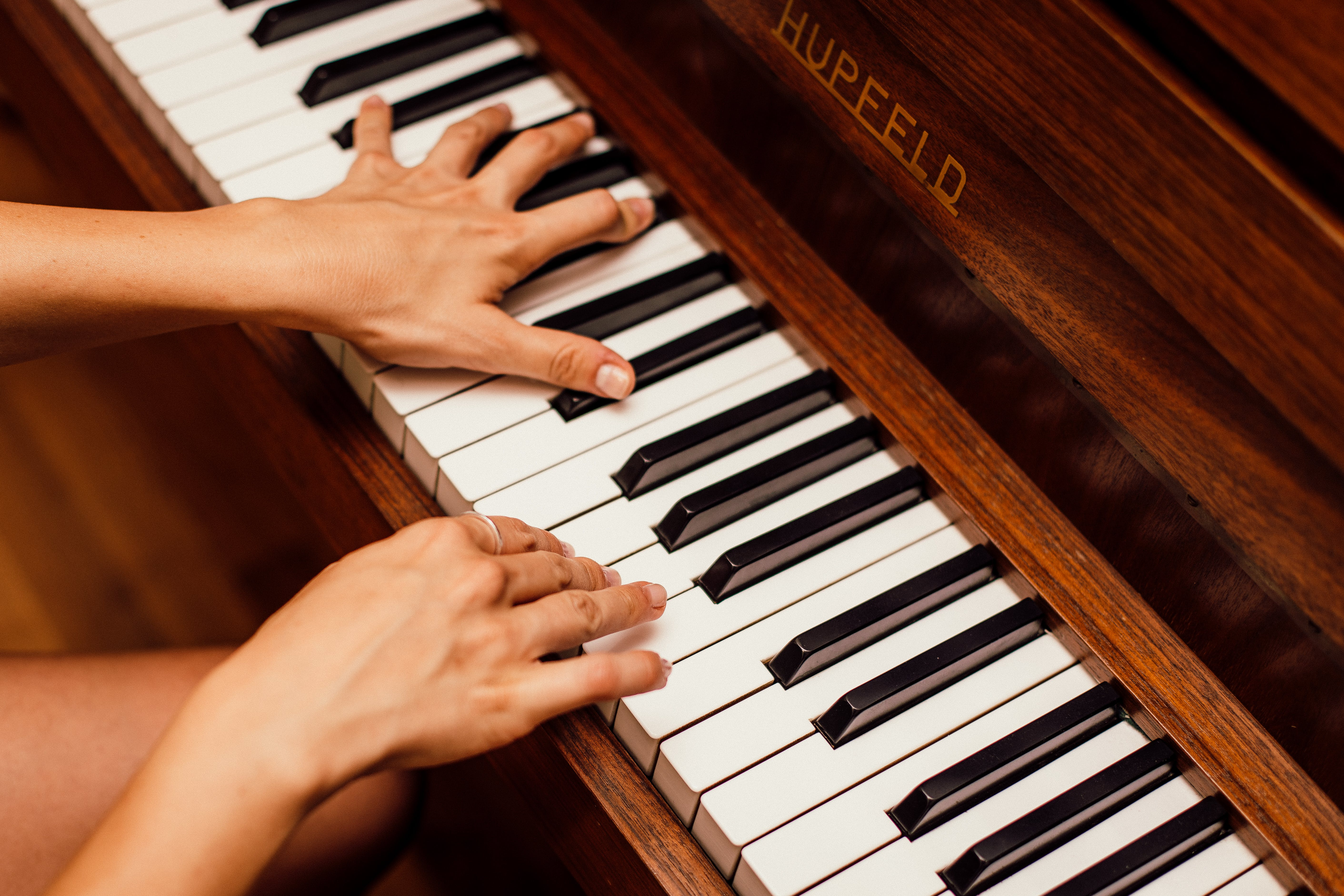Close-Up Photo Of Person Playing Piano