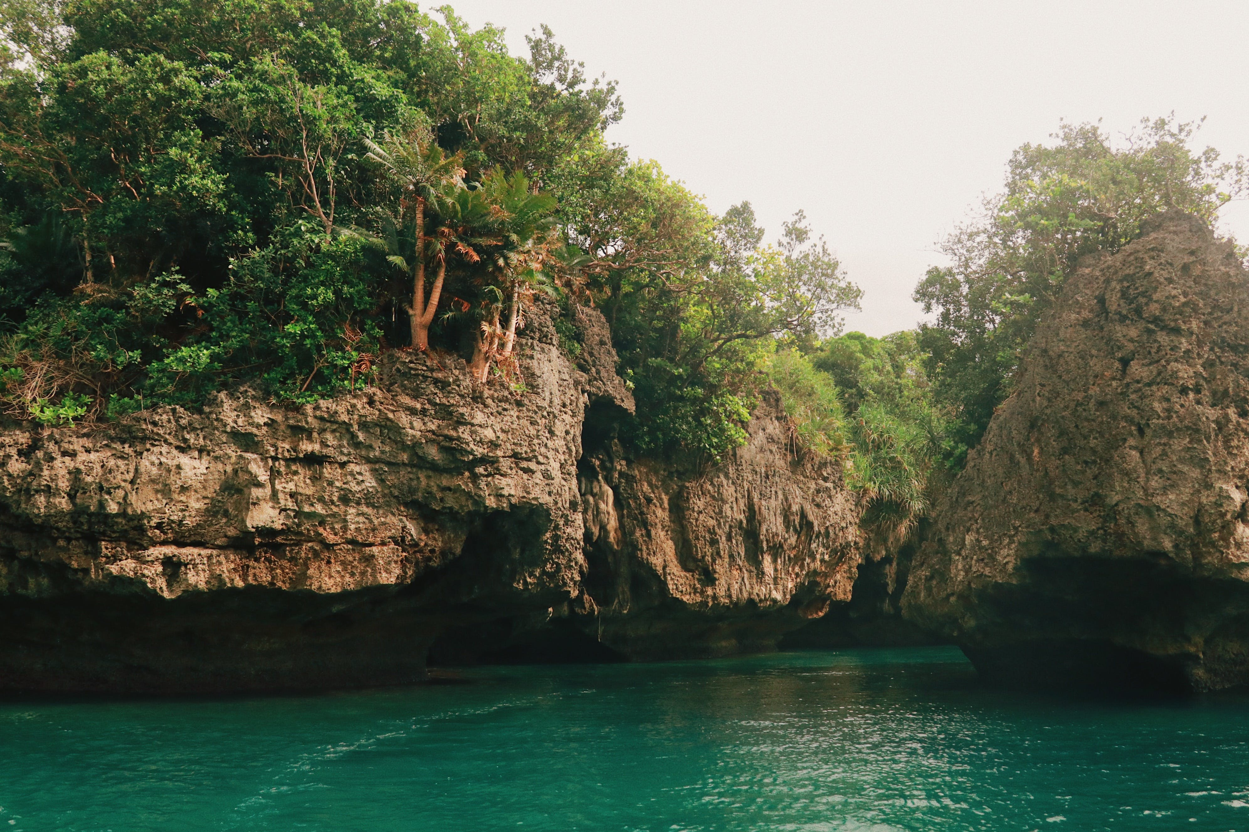 Rocky Cliff and Emerald Green Water View