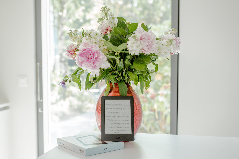 Potted Pink Petaled Flower Near Black Tablet