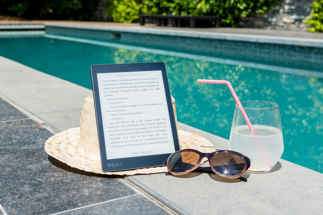 Black Kobo Table, Sunglasses, and a Glass of juice at Pool Edge