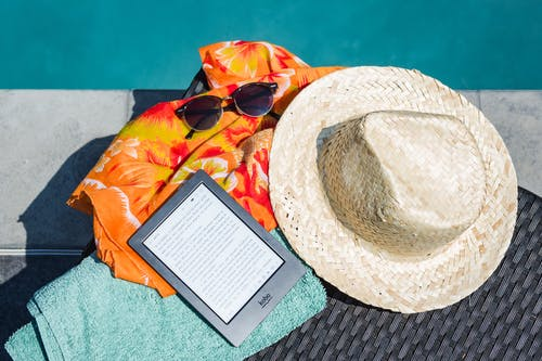 Black Amazon Kindle Tablet Near Brown Drawstring Sun Hat