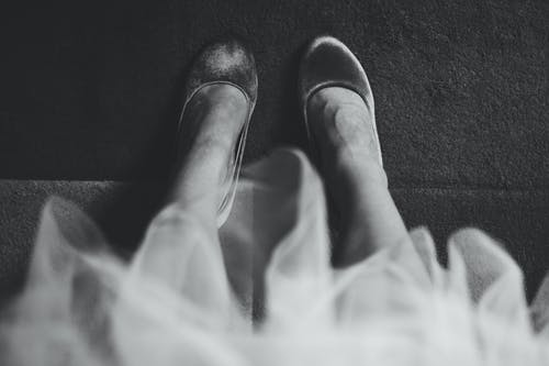 Grayscale Photography Of Woman Wearing Closed-toe Shoes