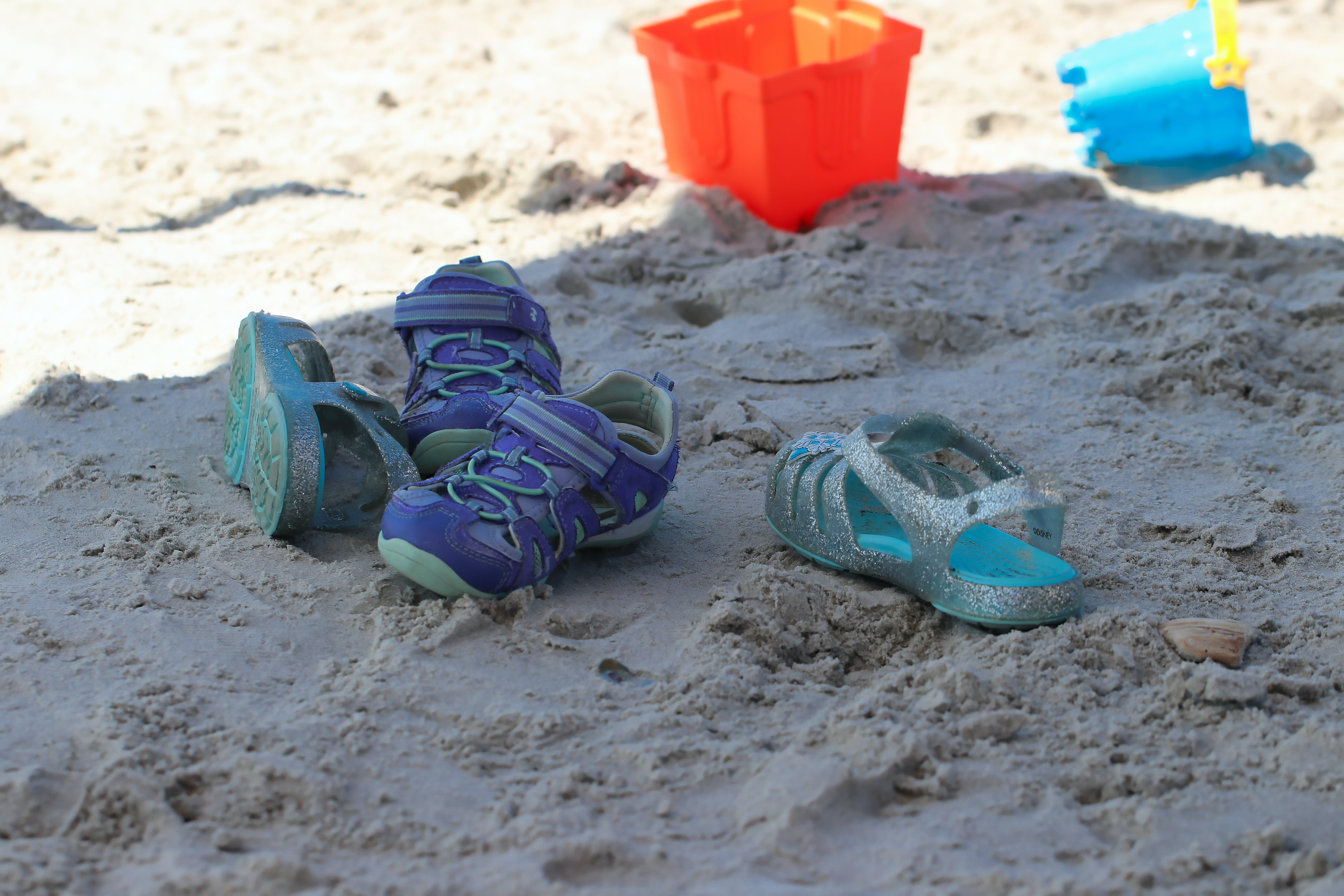 Free stock photo of beach, children's shoes, sand toys