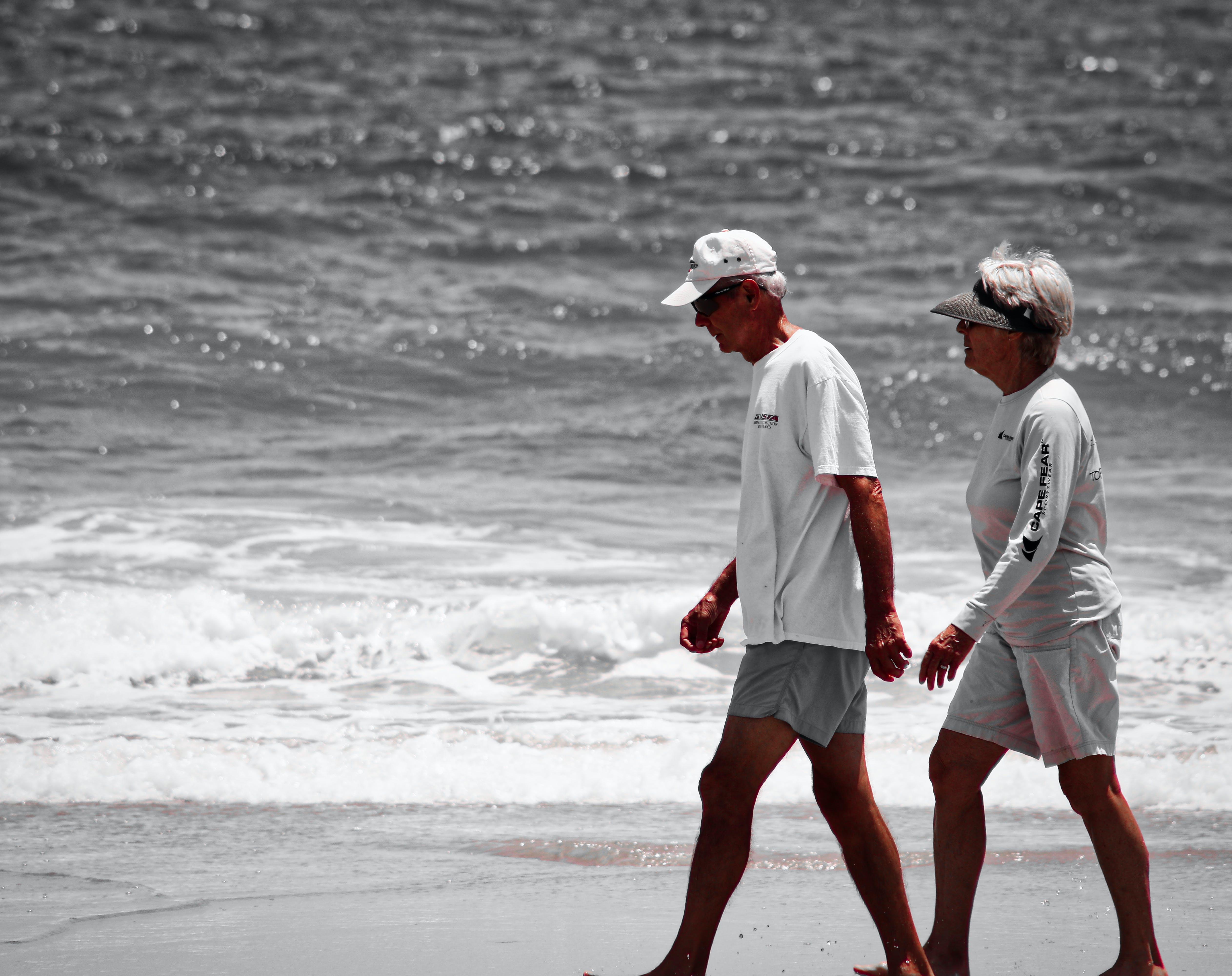 Free stock photo of beach, couple walking, ocean