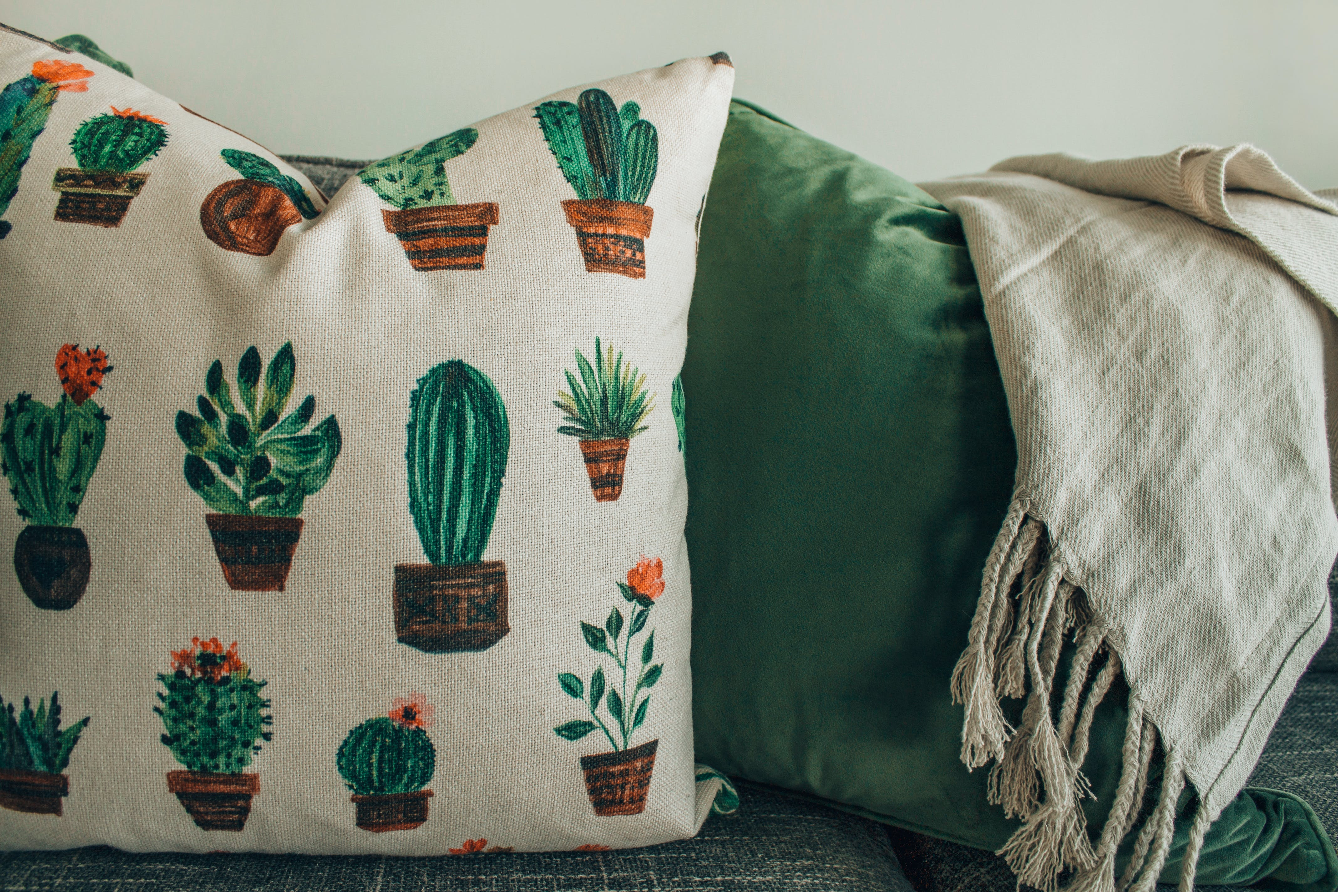 White, Green, and Brown Throw Pillow