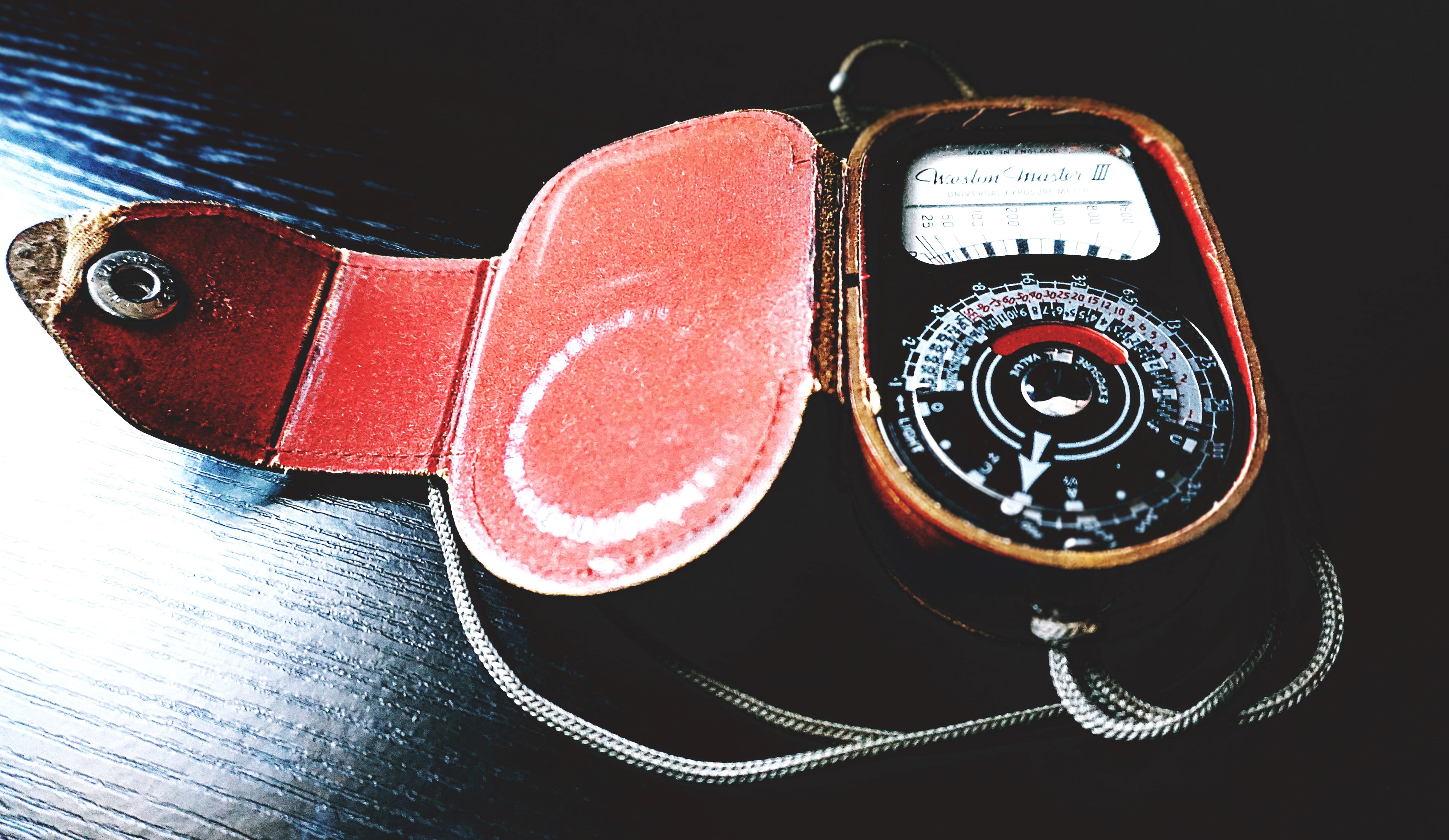 Analog Device on Black Wooden Surface