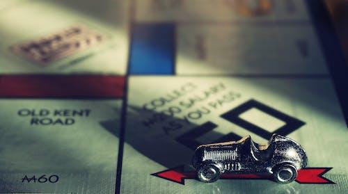 Foto profissional grátis de banco imobiliário, brincadeiras, carro de brinquedo, close