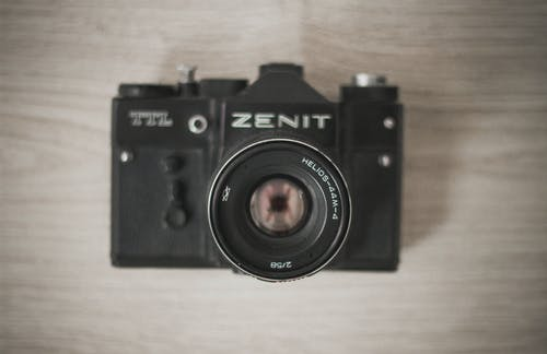 Flat-lay Photograph of Black Zenit Camera