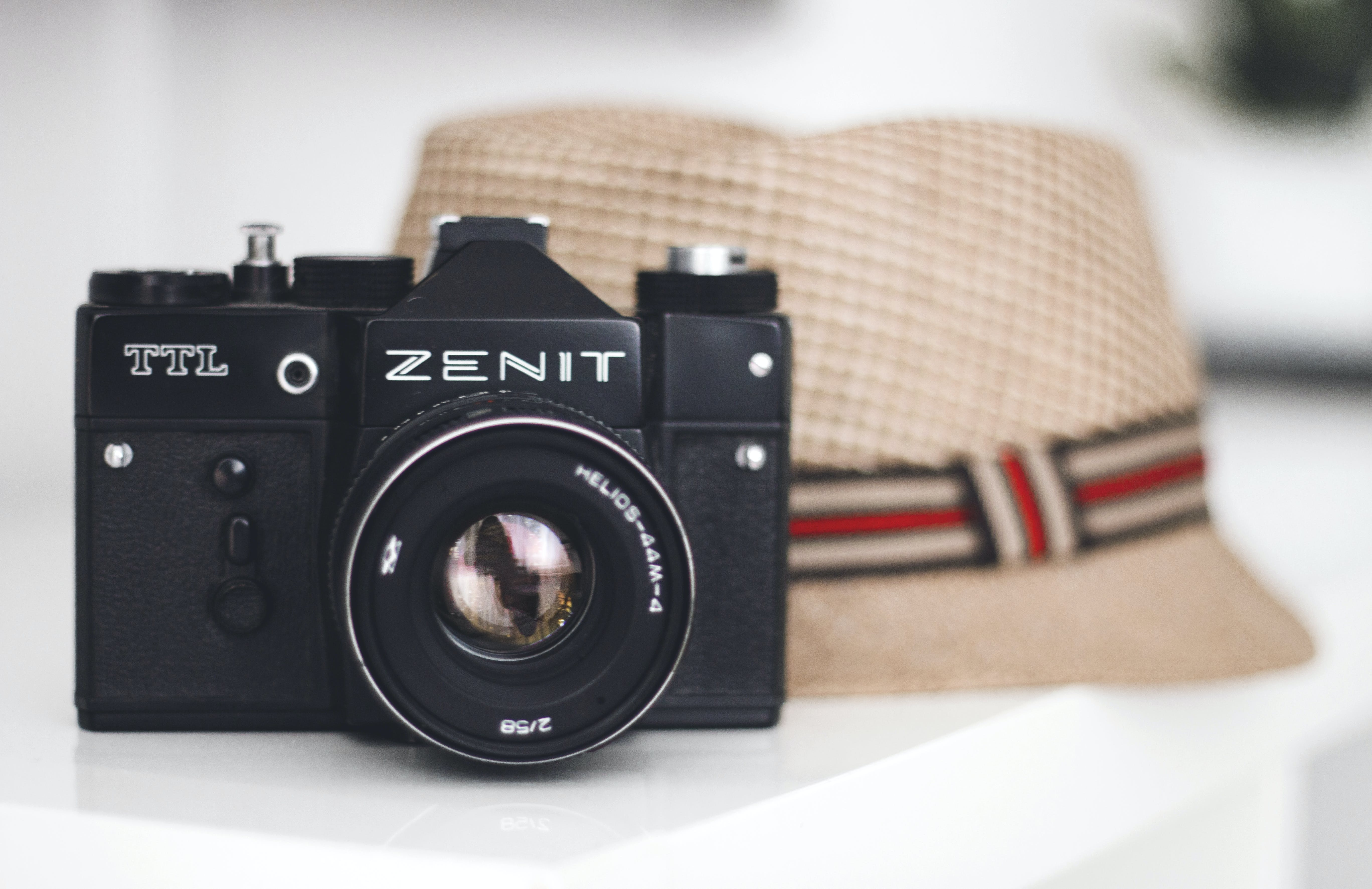 Zenit Brand Camera Beside Fedora Hat
