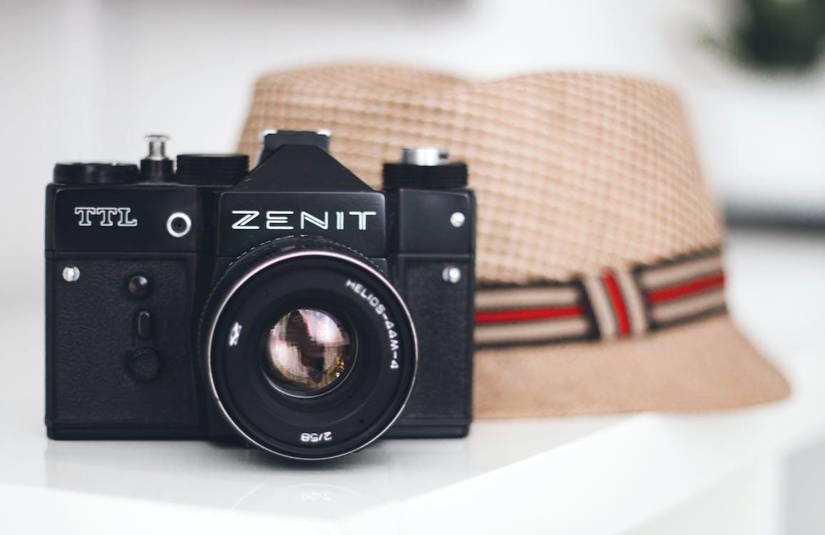 Zenit Brand Camera Beside Fedora Hat