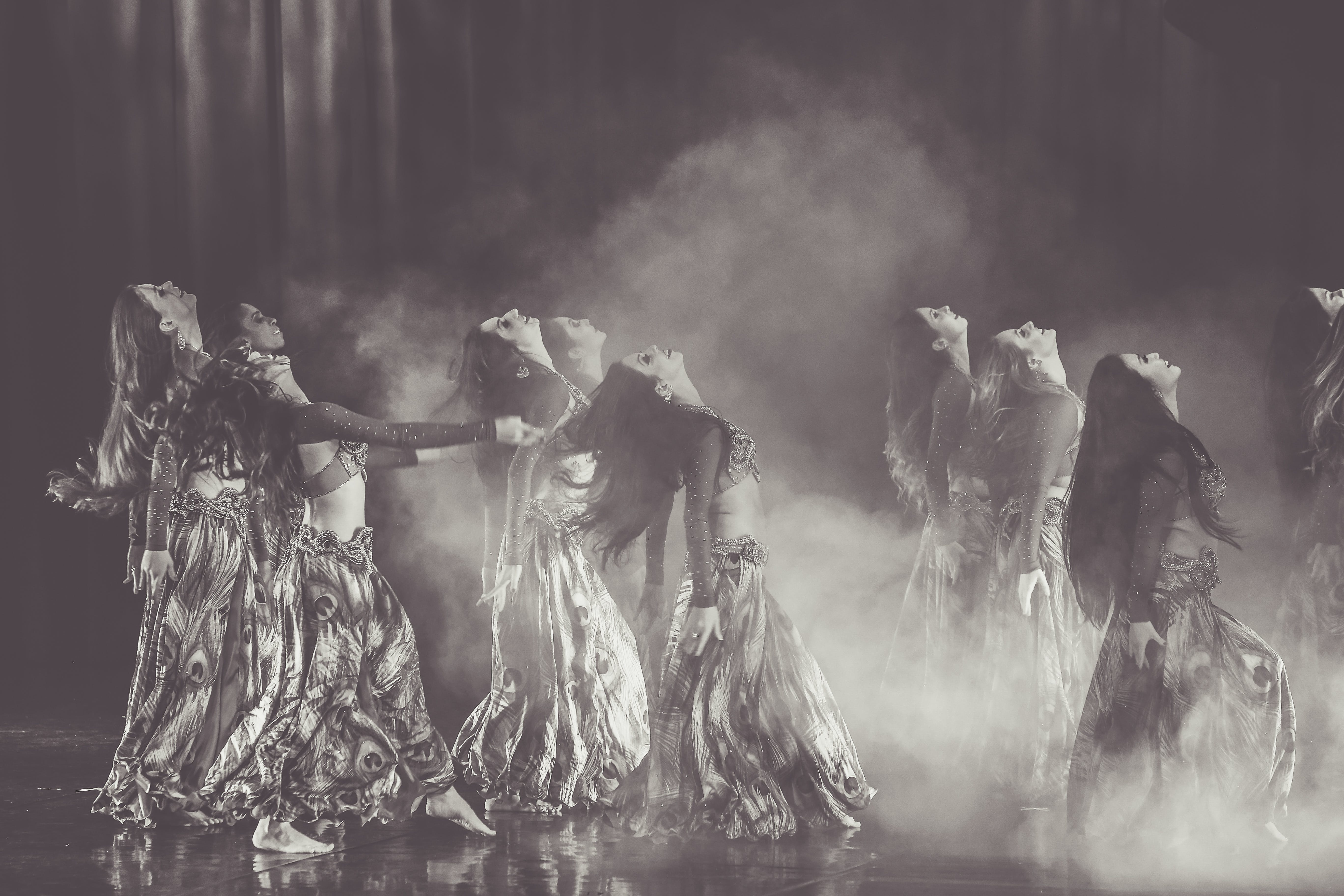 Monochrome Photography of Women Performing On Stage